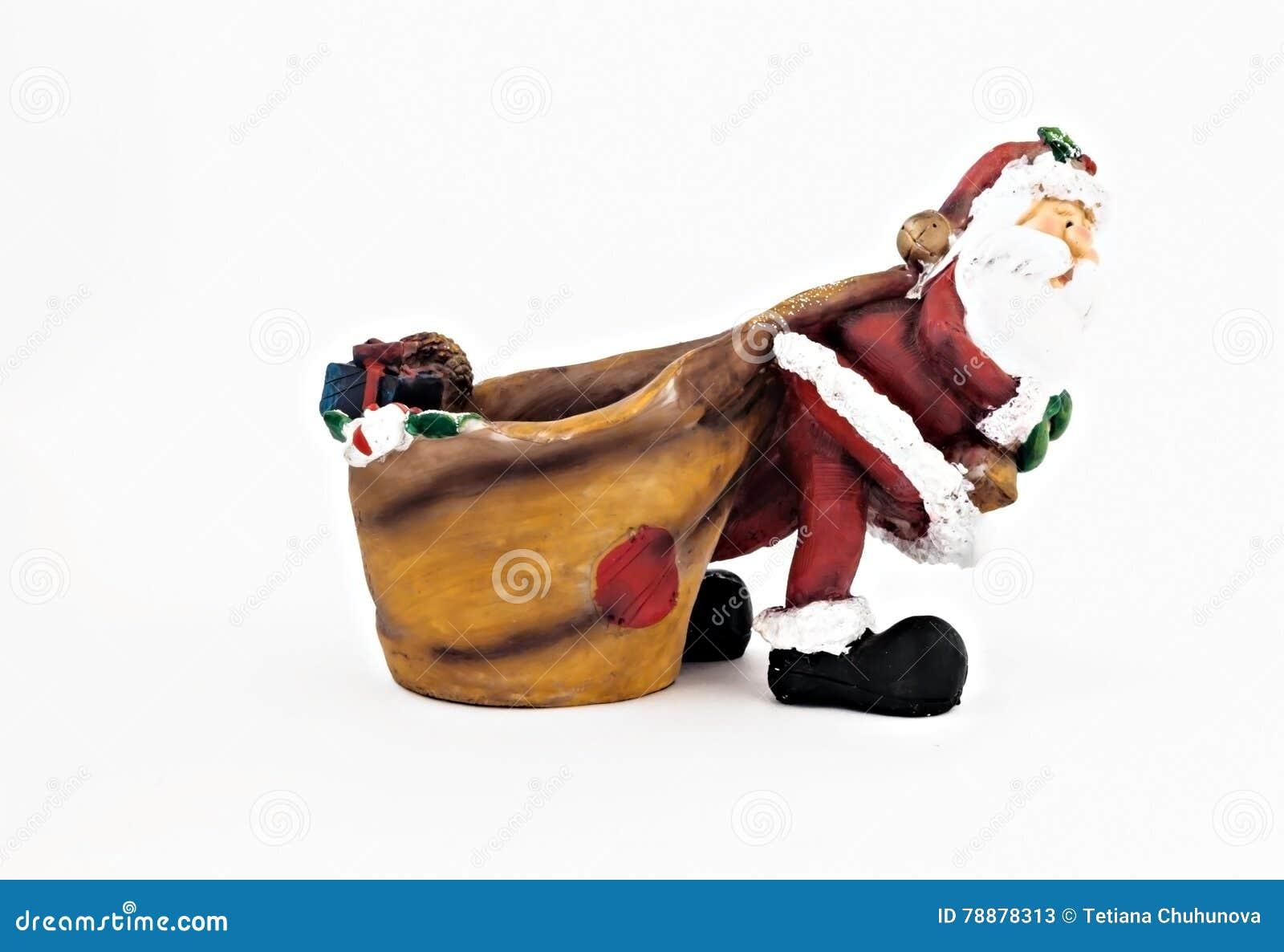 Keramische Figürchen von Santa Claus mit einem großen Sack lokalisiert