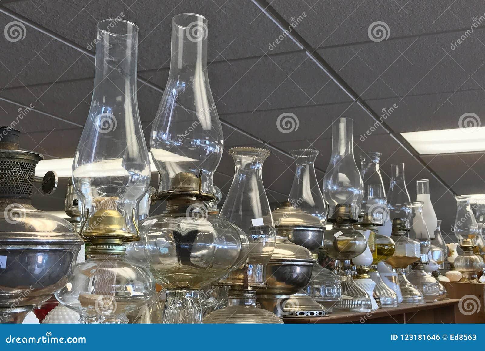 Kerosene Lamps Or Lanterns On A Shelf In A Thrift Store