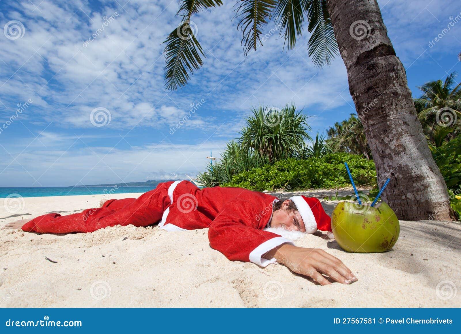 Kerstman onder tropische palm
