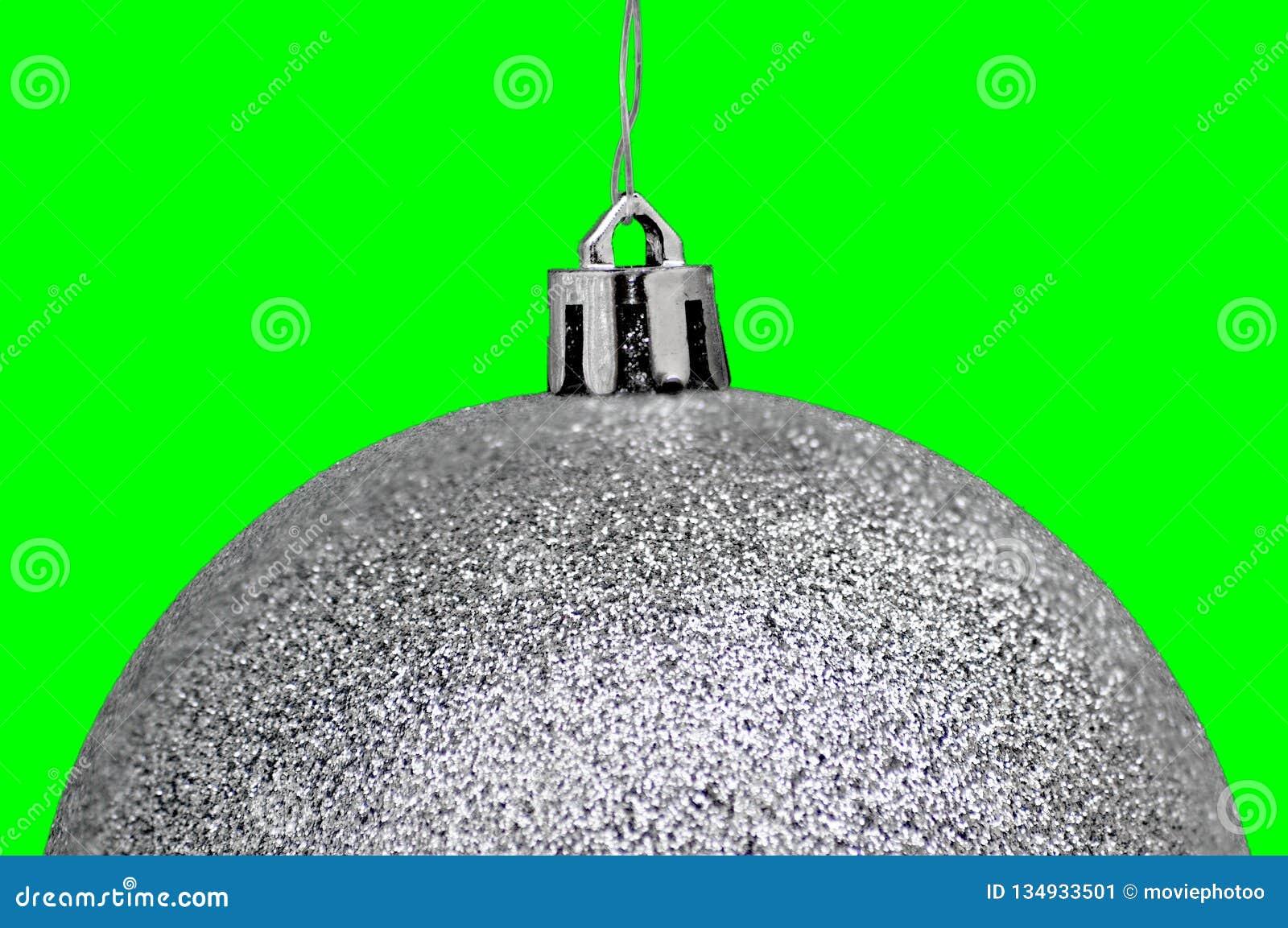 Kerstmis & Nieuwjaar zilveren kristallen bollen tegen groene achtergrond