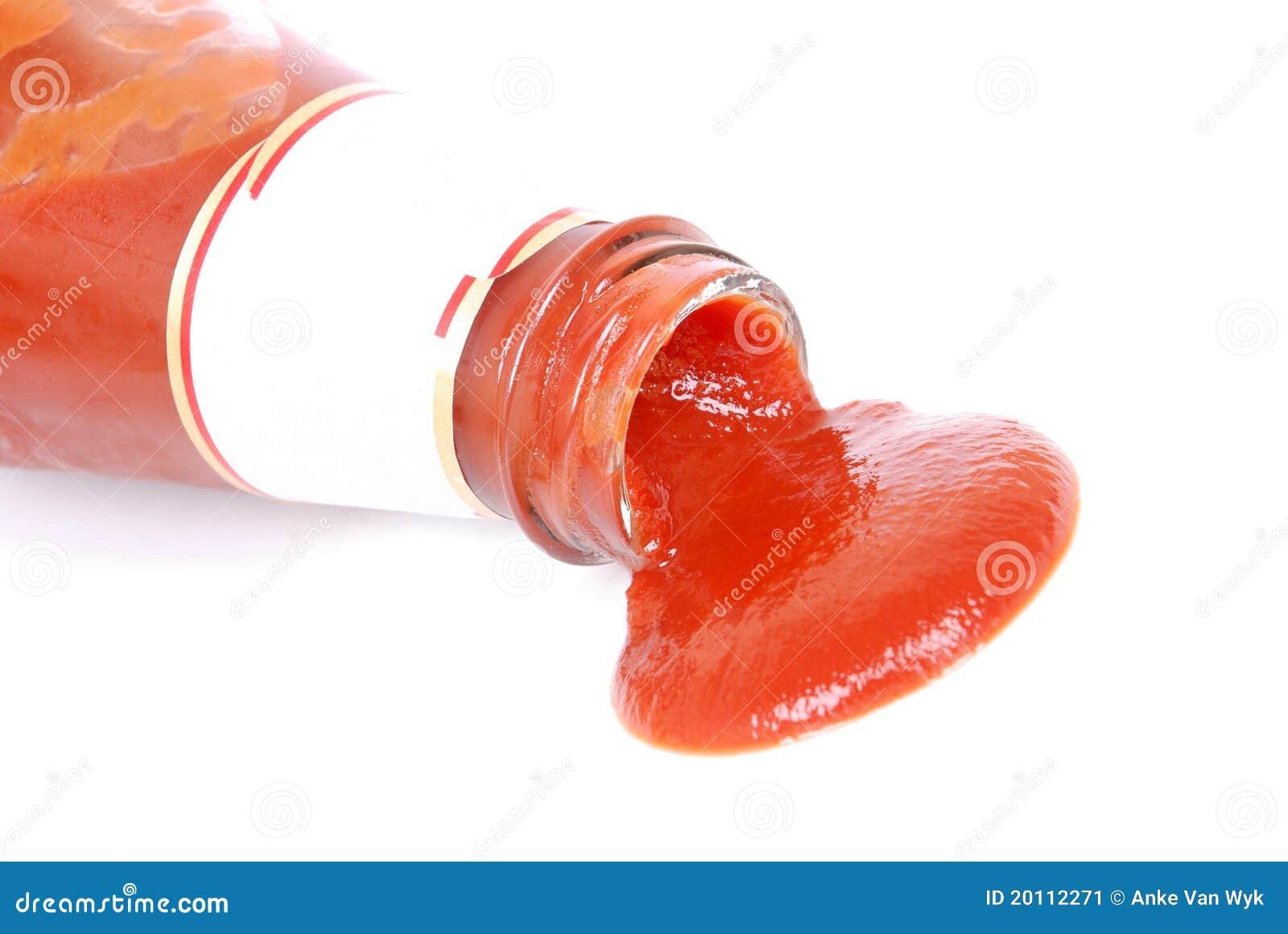 closeup of a big ketchup sauce spill running out of a glass bottle ...