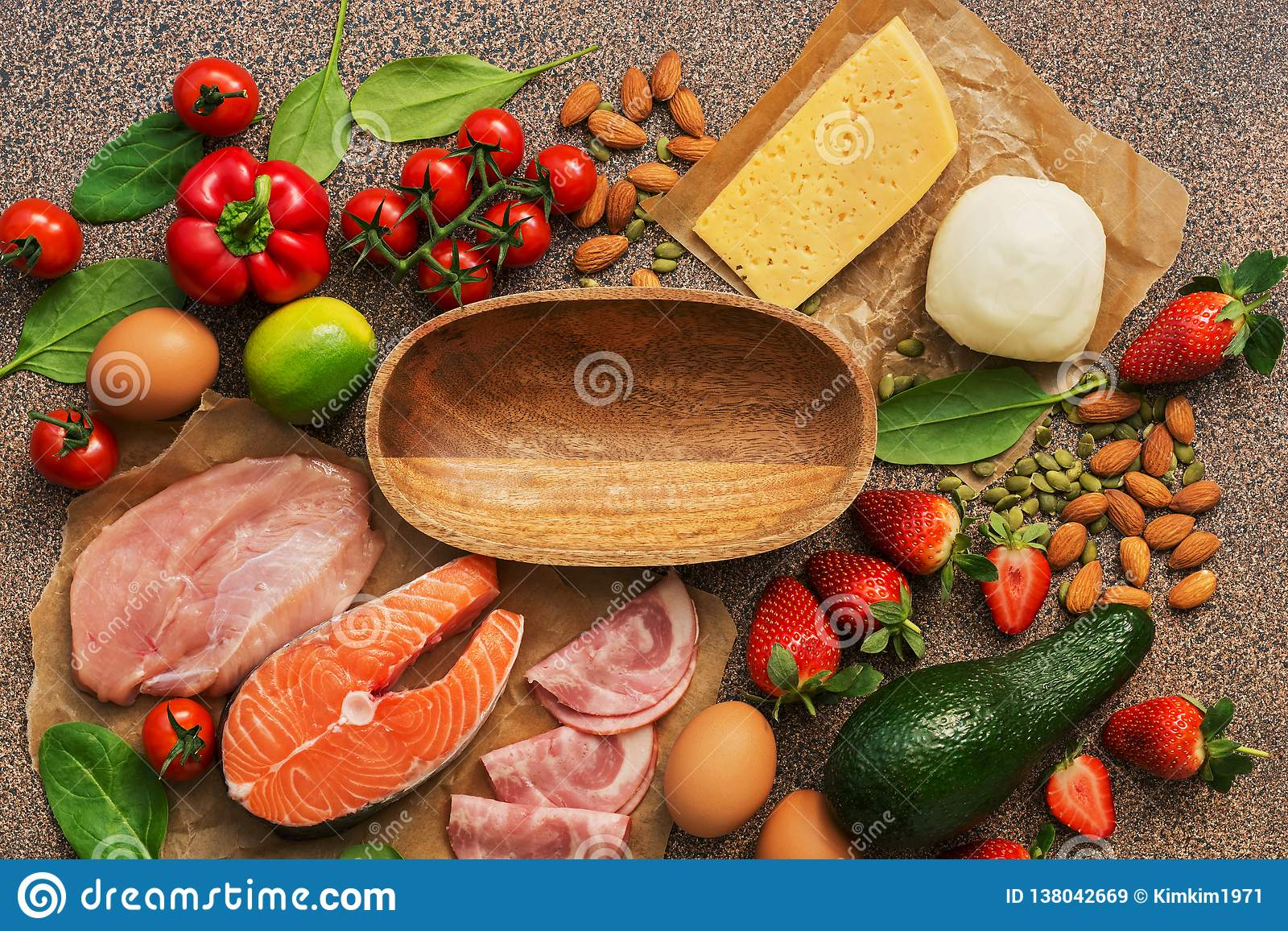 Keto diet concept.Healthy foods low in carbohydrates. Salmon, chicken, vegetables, strawberries, nuts, eggs and tomatoes, empty