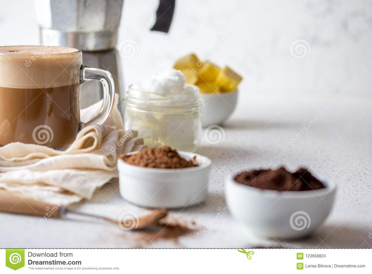 KETOGENIC KETO DIET DRINK. Coffe and cacao blended with coconut oil. Cup of bulletproof coffe with cacao and ingredients