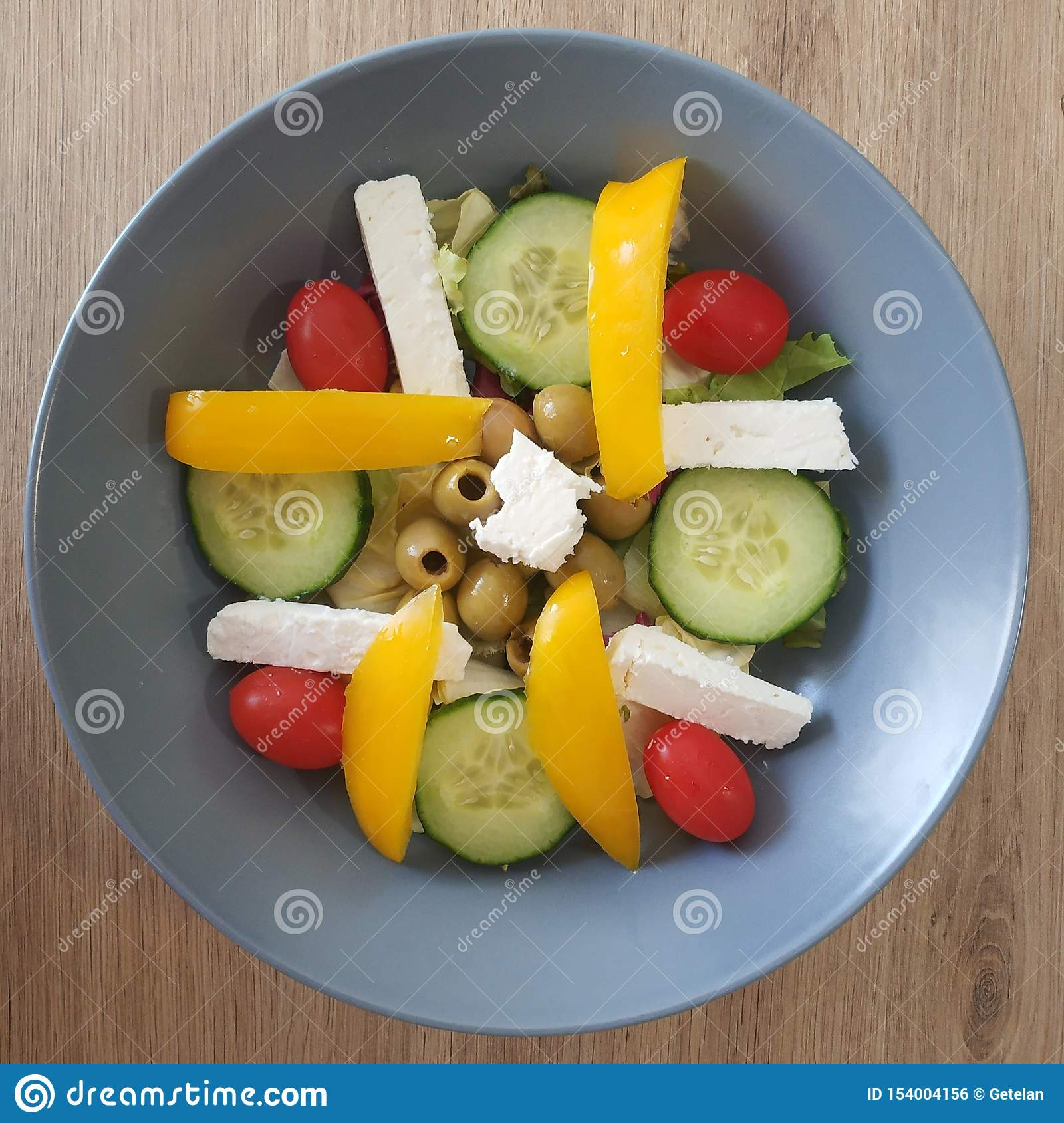 Ketogenic meal, feta cheese salad with tomato, cucumber, olive, bell pepper. Keto food for weight loss. Healthy diet breakfast