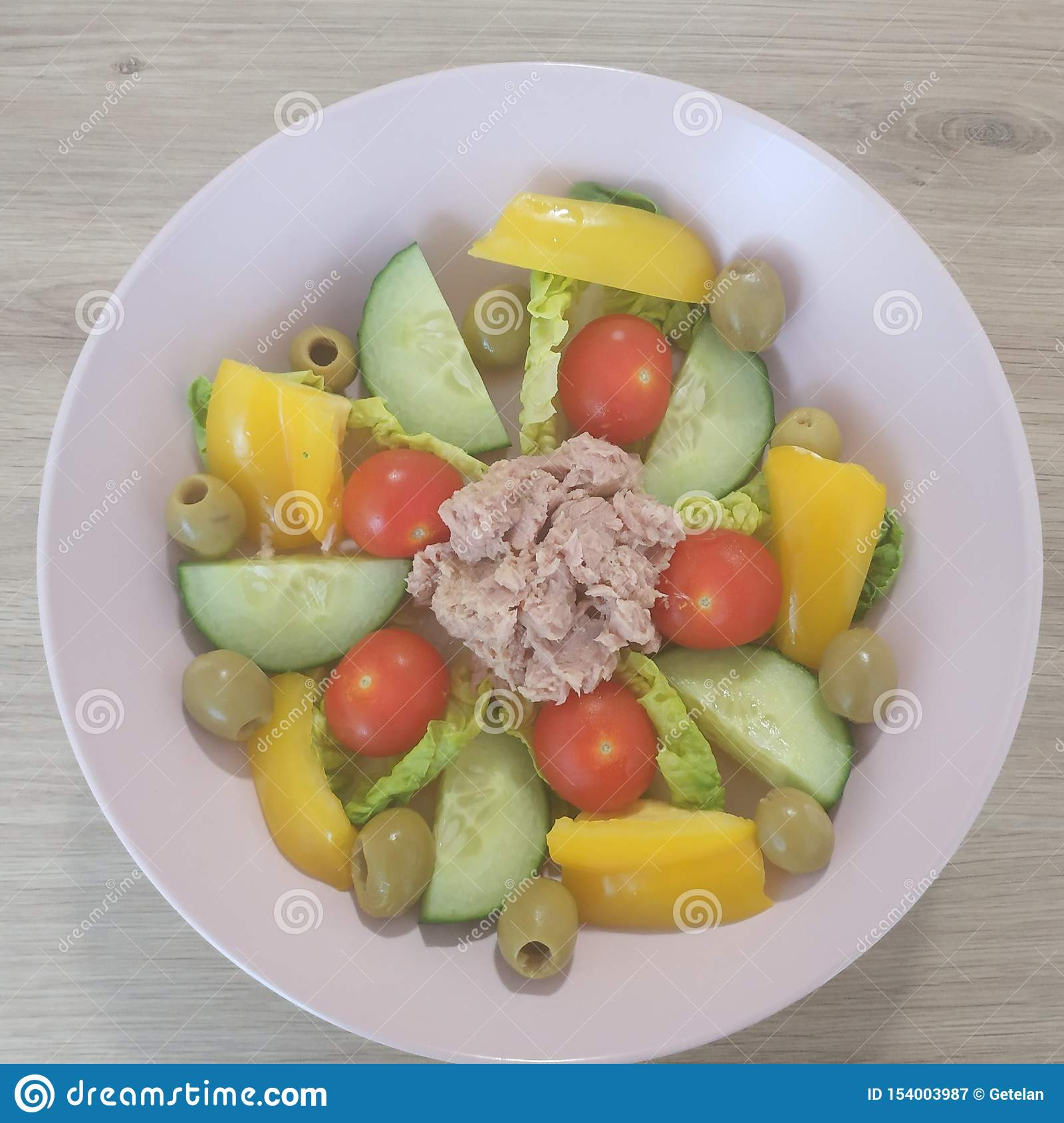 Ketogenic meal, tuna salad with tomatoes, bell pepper, cucumber, olives. Keto food for weight loss. Healthy diet dinner