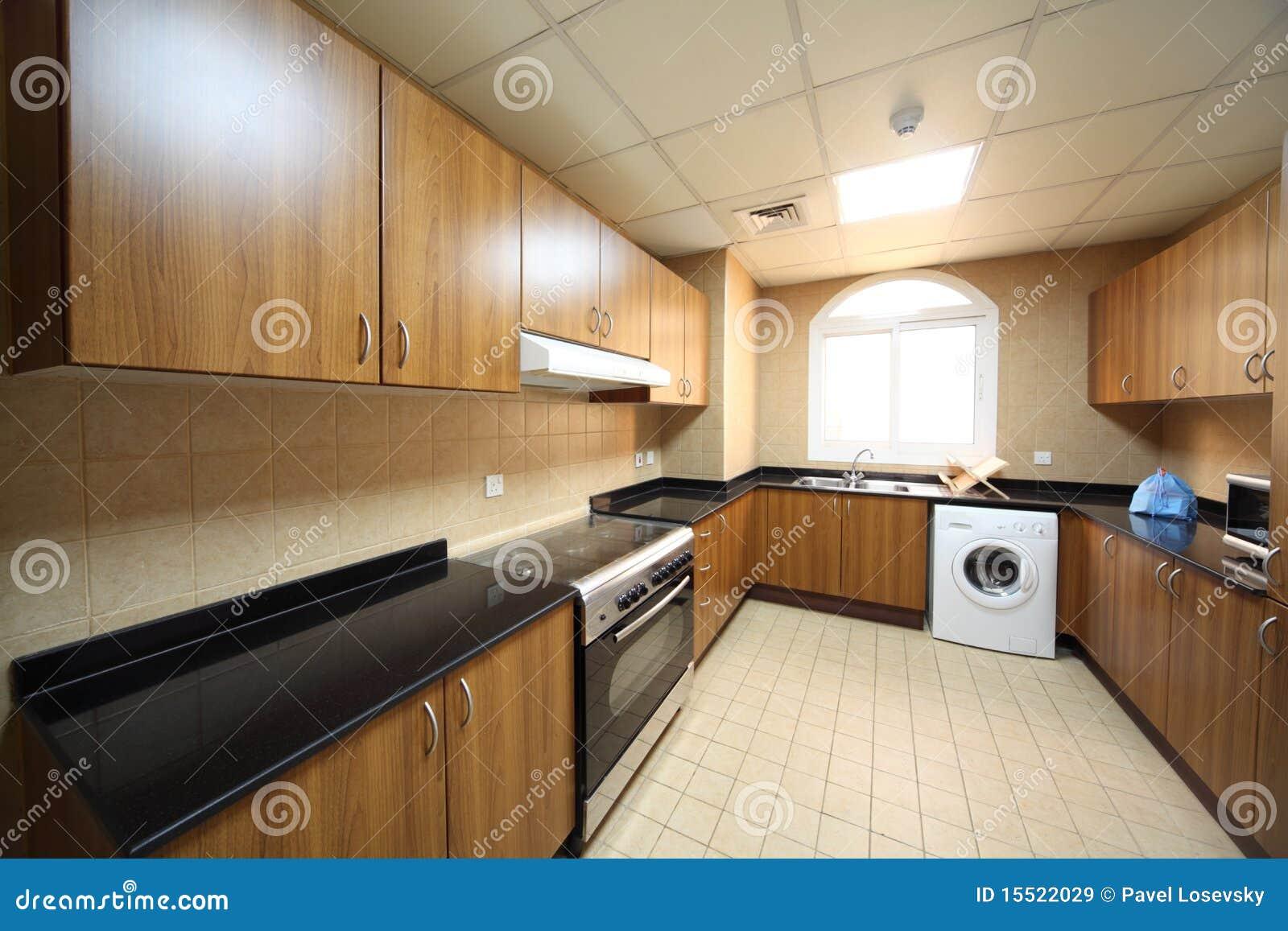 Keuken met kasten, wasmachine en kooktoestel royalty vrije stock ...