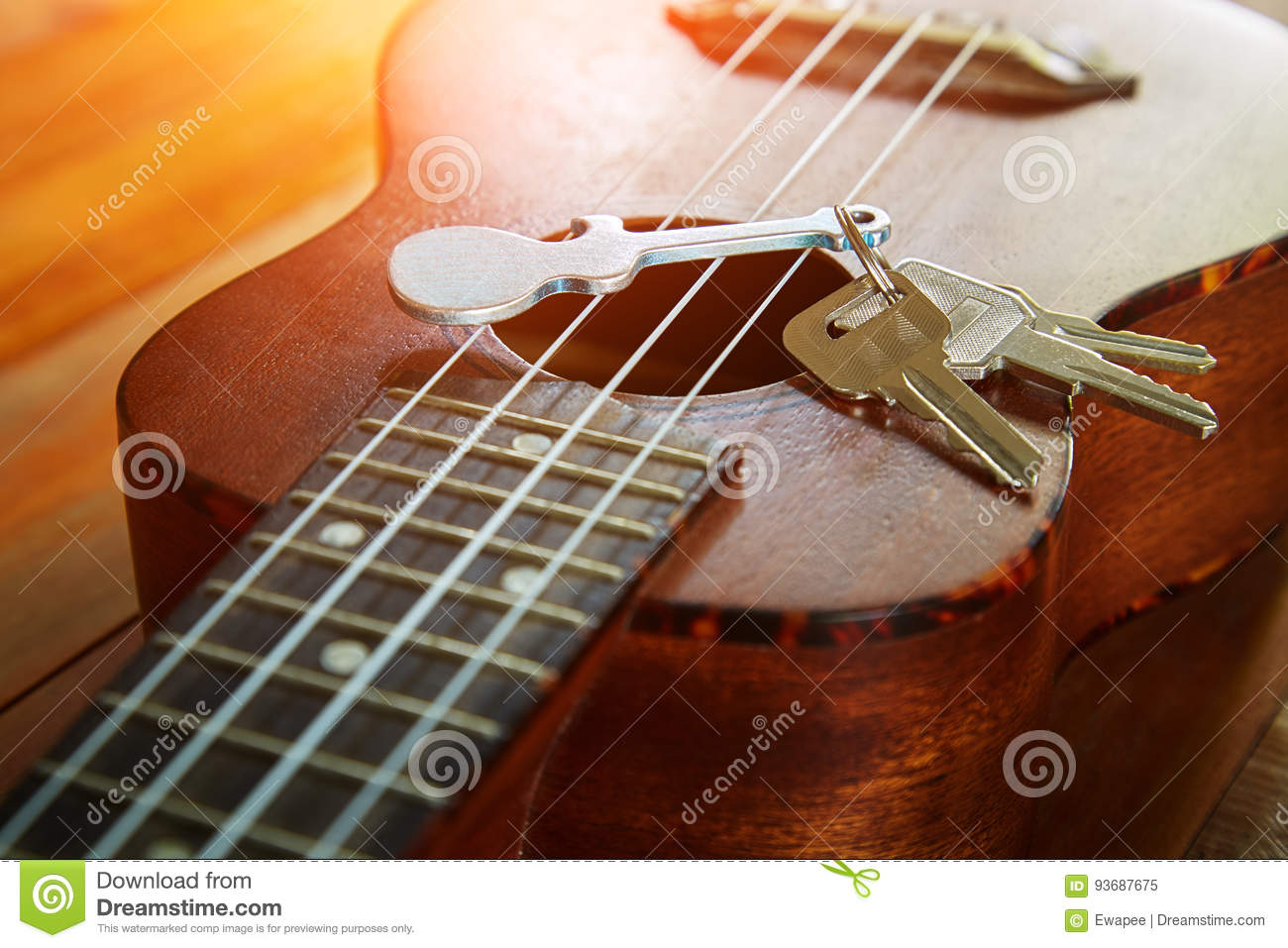 Key with keychain in form of guitar