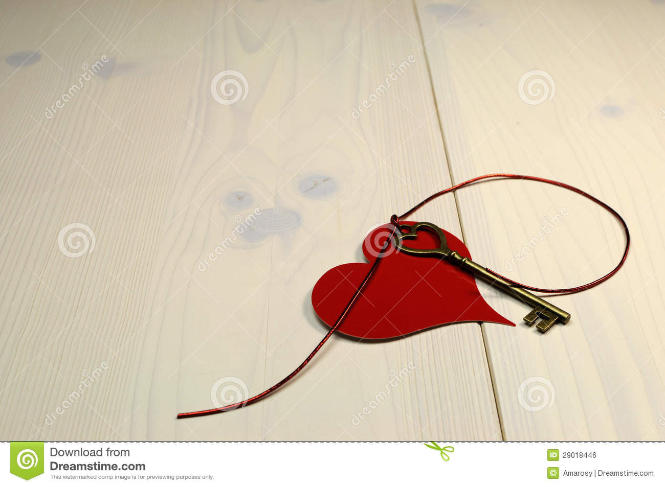Key to My Heart  love concept, with gold heart shape key and red heart on white shabby chic wood table