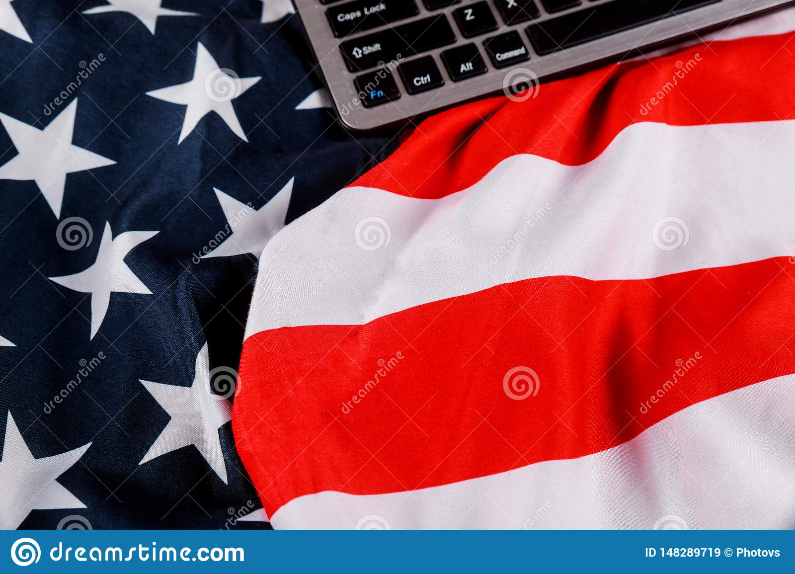 Keyboard with blank notepad with office table american flag