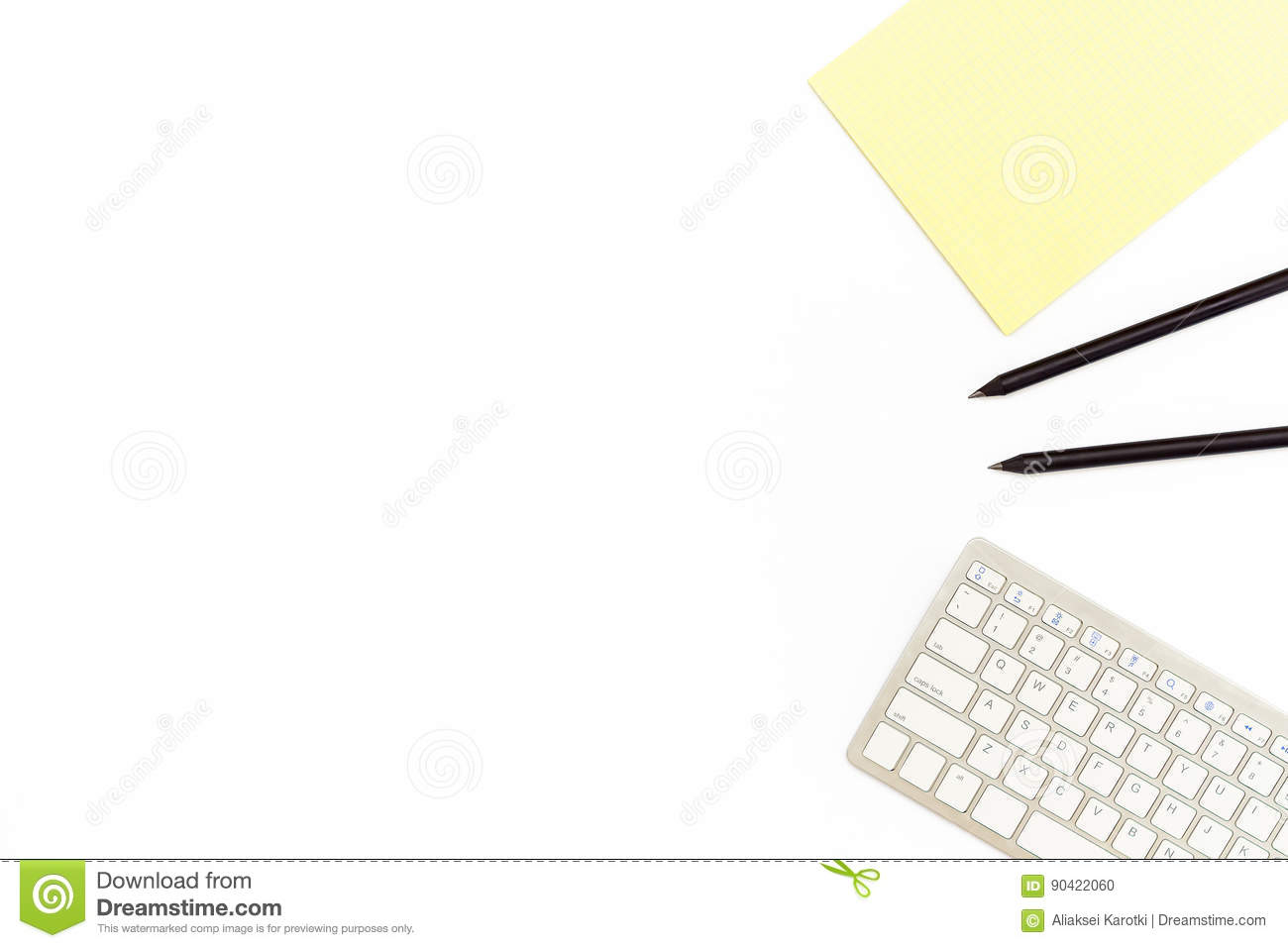 Keyboard, yellow notebook and two black pencil on a white background. Minimal concept of business workplace. Flat lay.