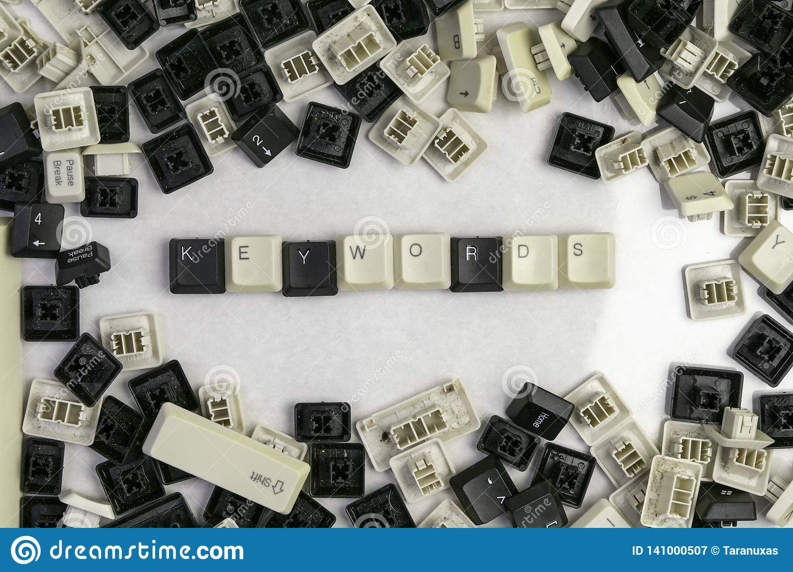 Keying works on microstocks, the word keywords folded from the keys of the old keyboard