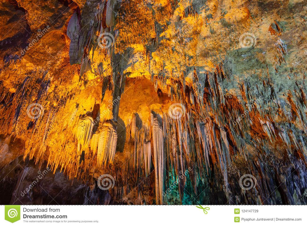 Khao bin cave of Thailand, inside cave view of multiple small slender stalactites on the ceiling of a dark cave