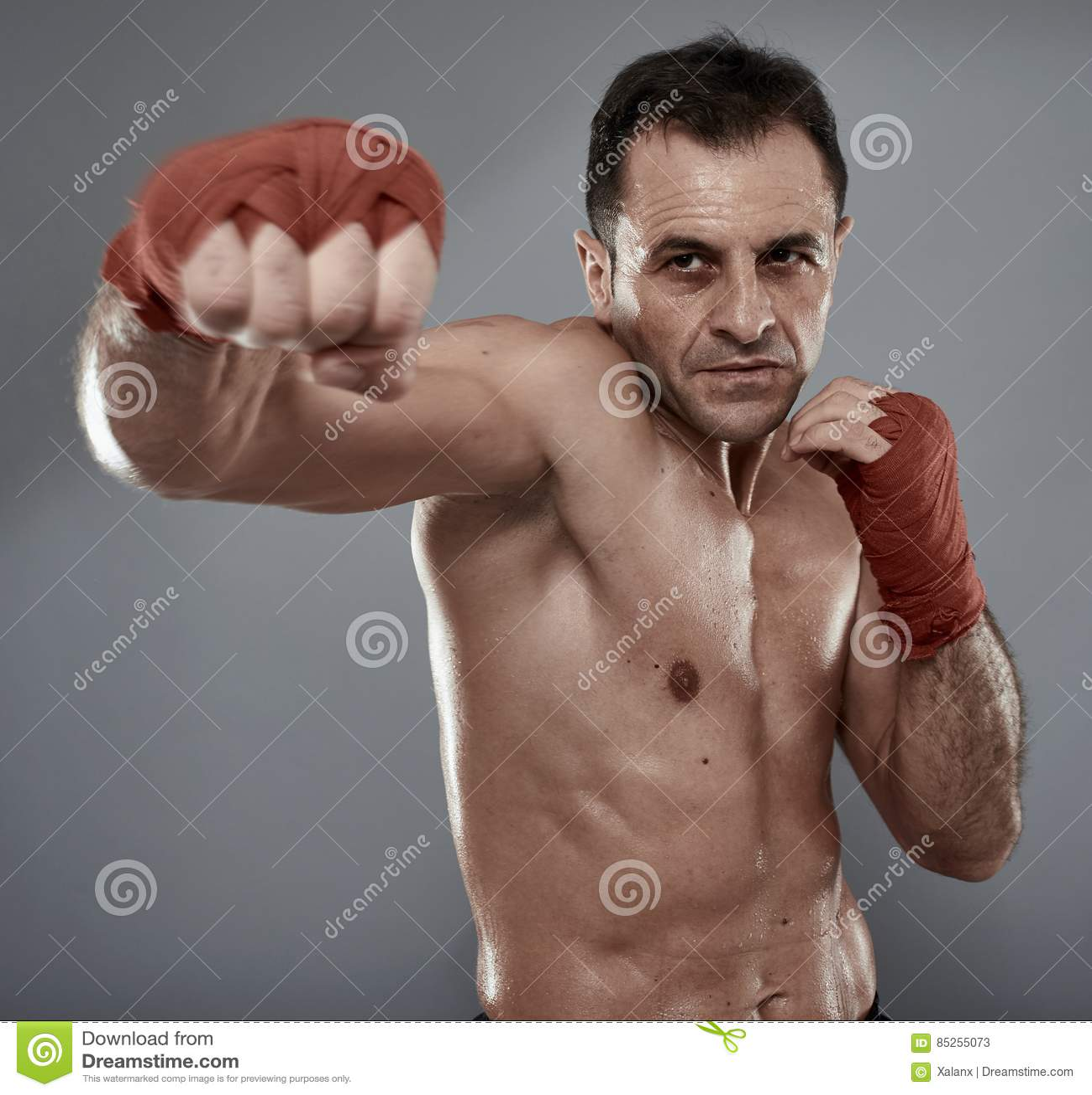 Kickbox fighter on gray background