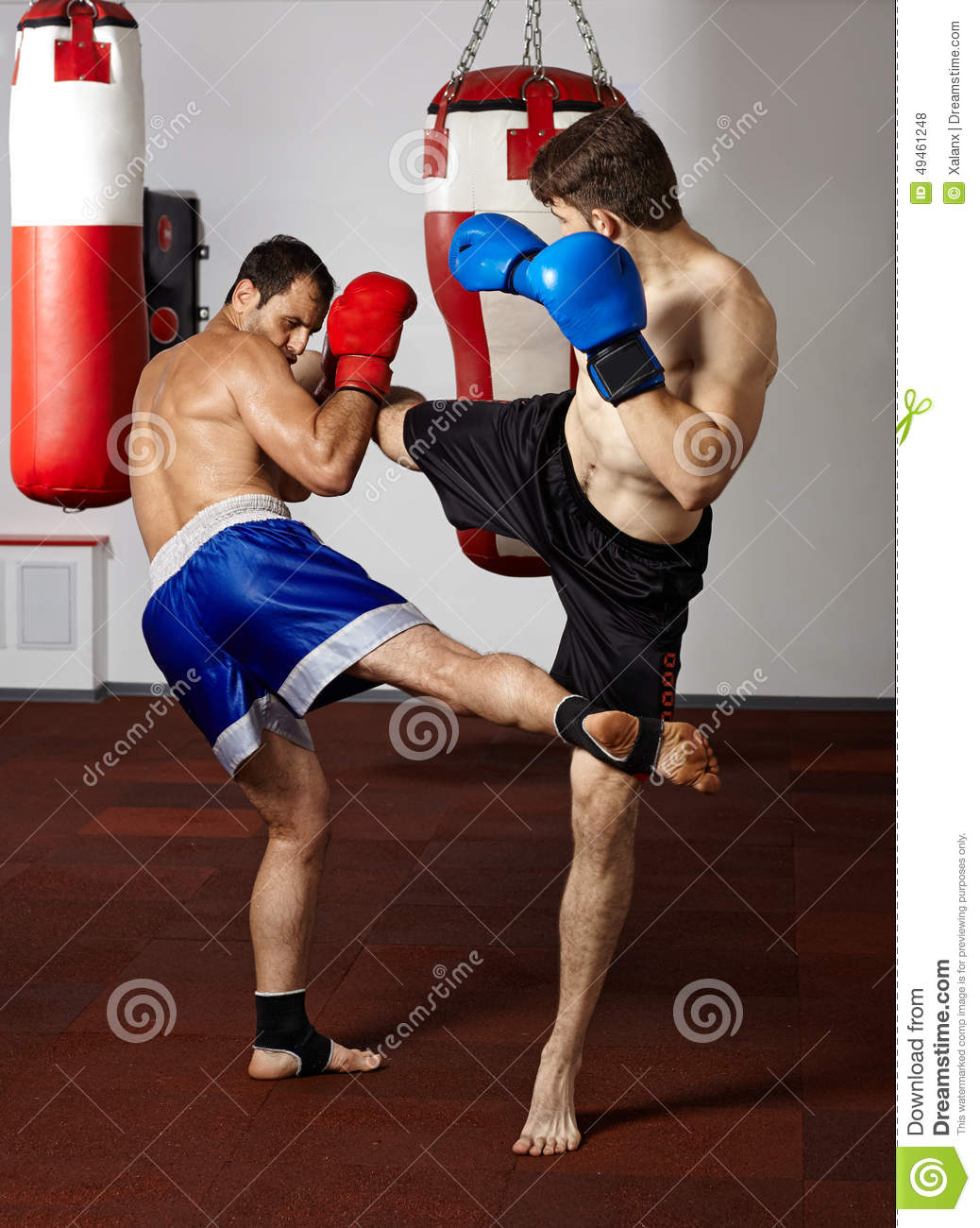 Kickbox fighters sparring in the gym