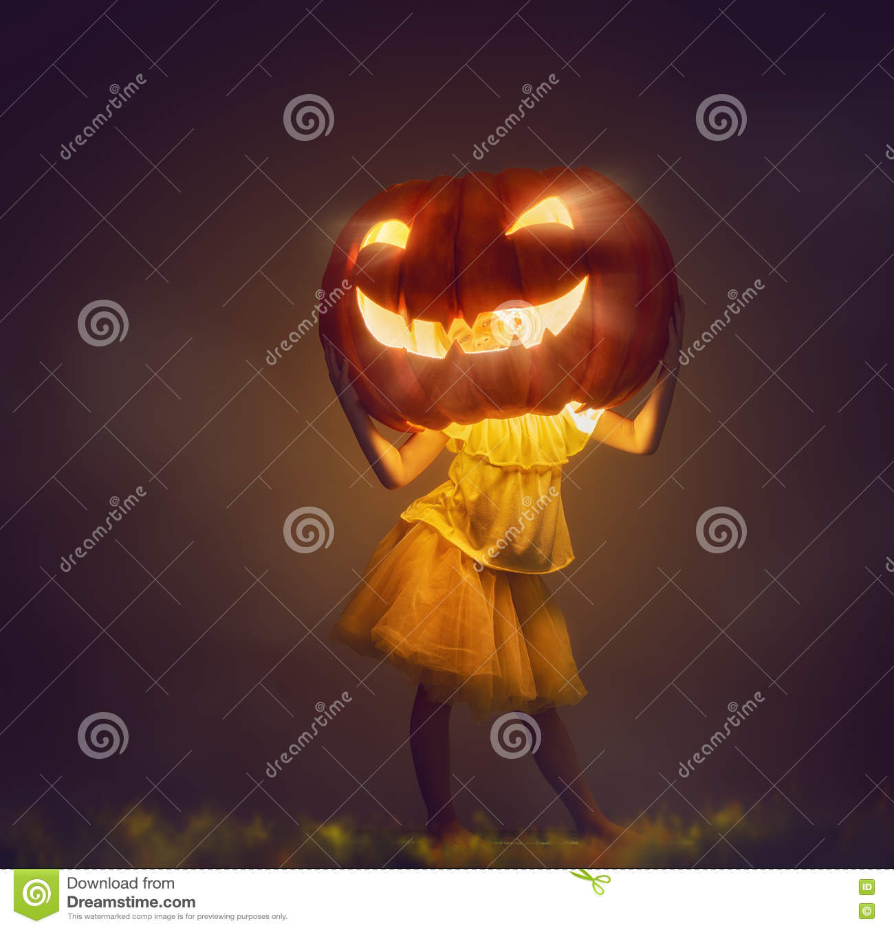 Kid with a big pumpkin head