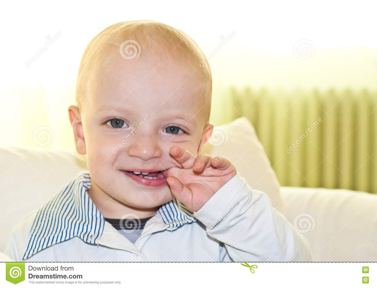 kid biting his finger royalty free stock images image