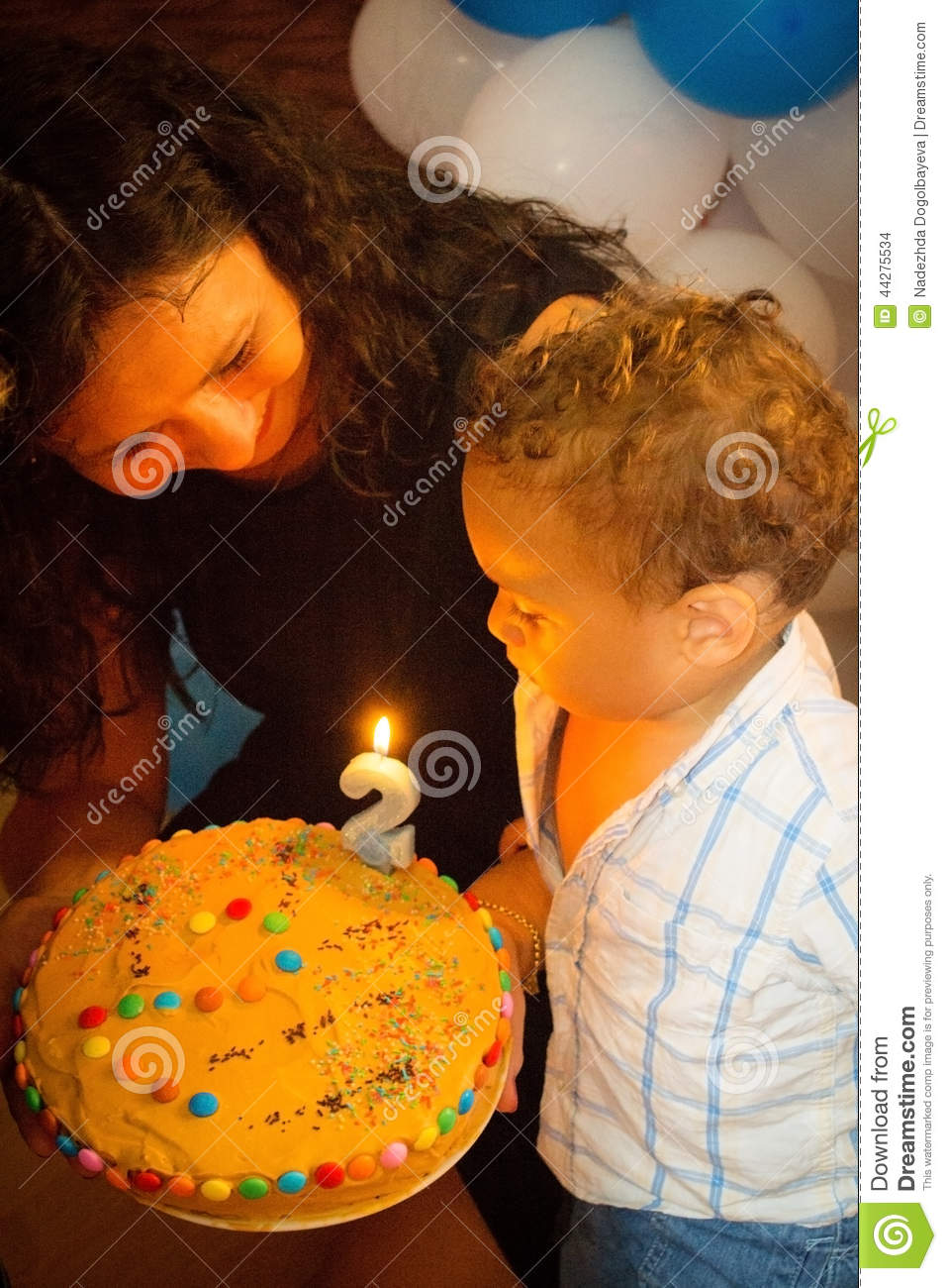Kid Blowing Candles On Birthday Cake Stock Photo Image