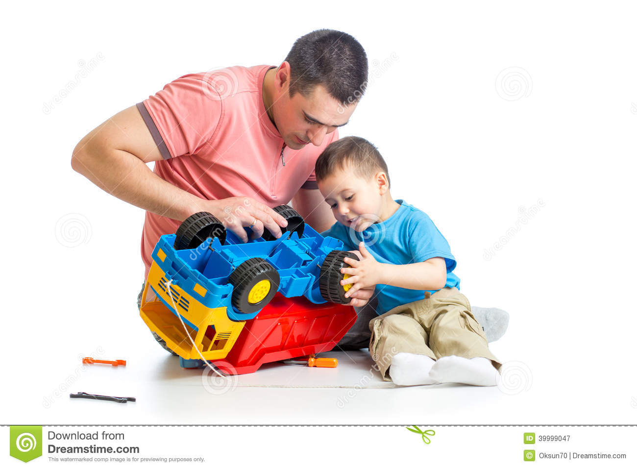 Kid boy and dad repair toy trunk