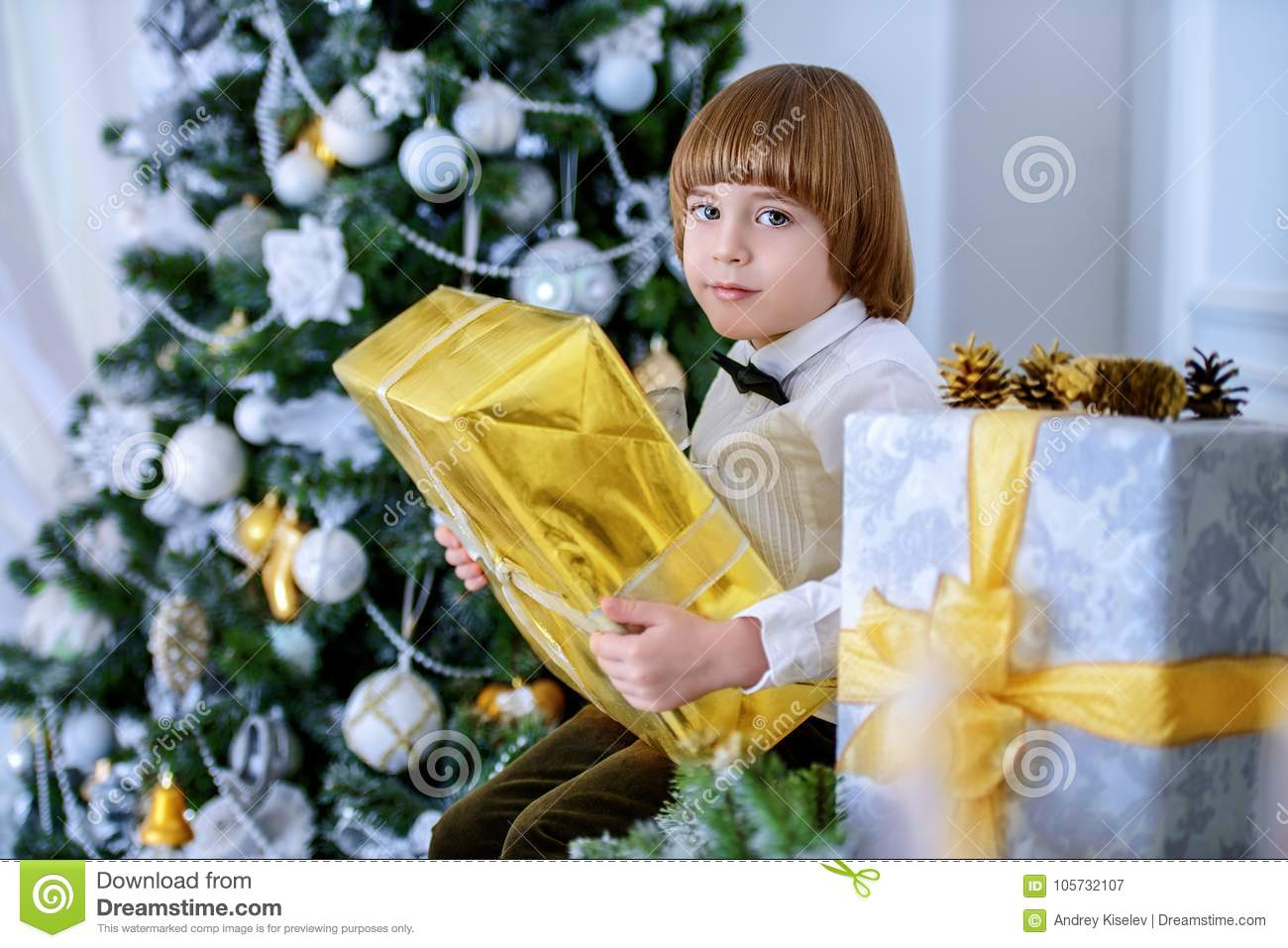 Kid boy with gift stock image. Image of people, interior - 105732107