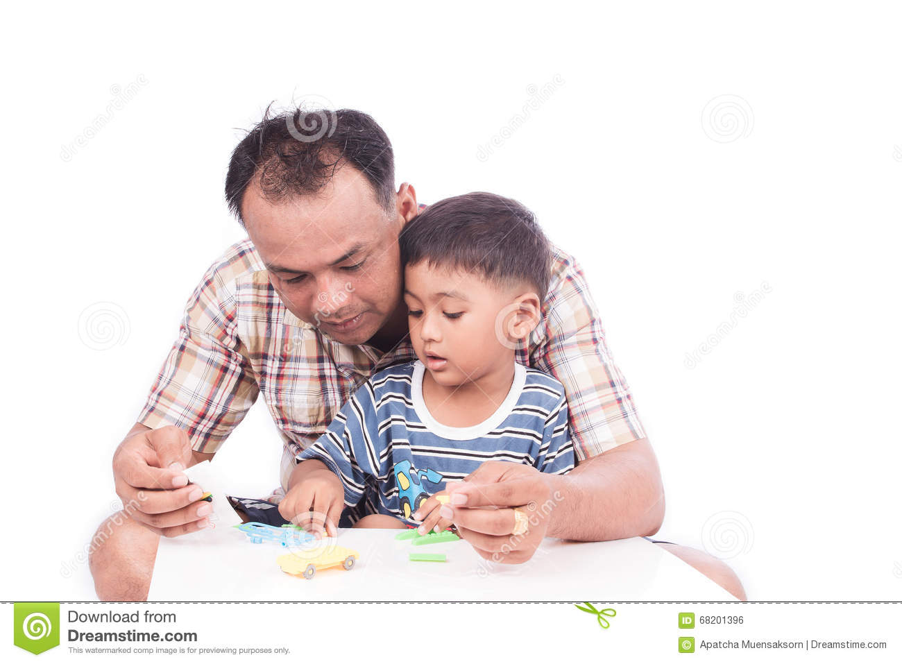 Boy Toys For Dads : Kid boy and his dad assembly toy car stock photo image
