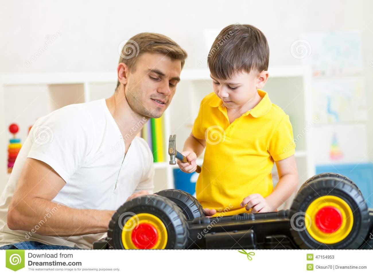 Boy Toys For Dads : Kid boy and his dad repair toy car stock photo image