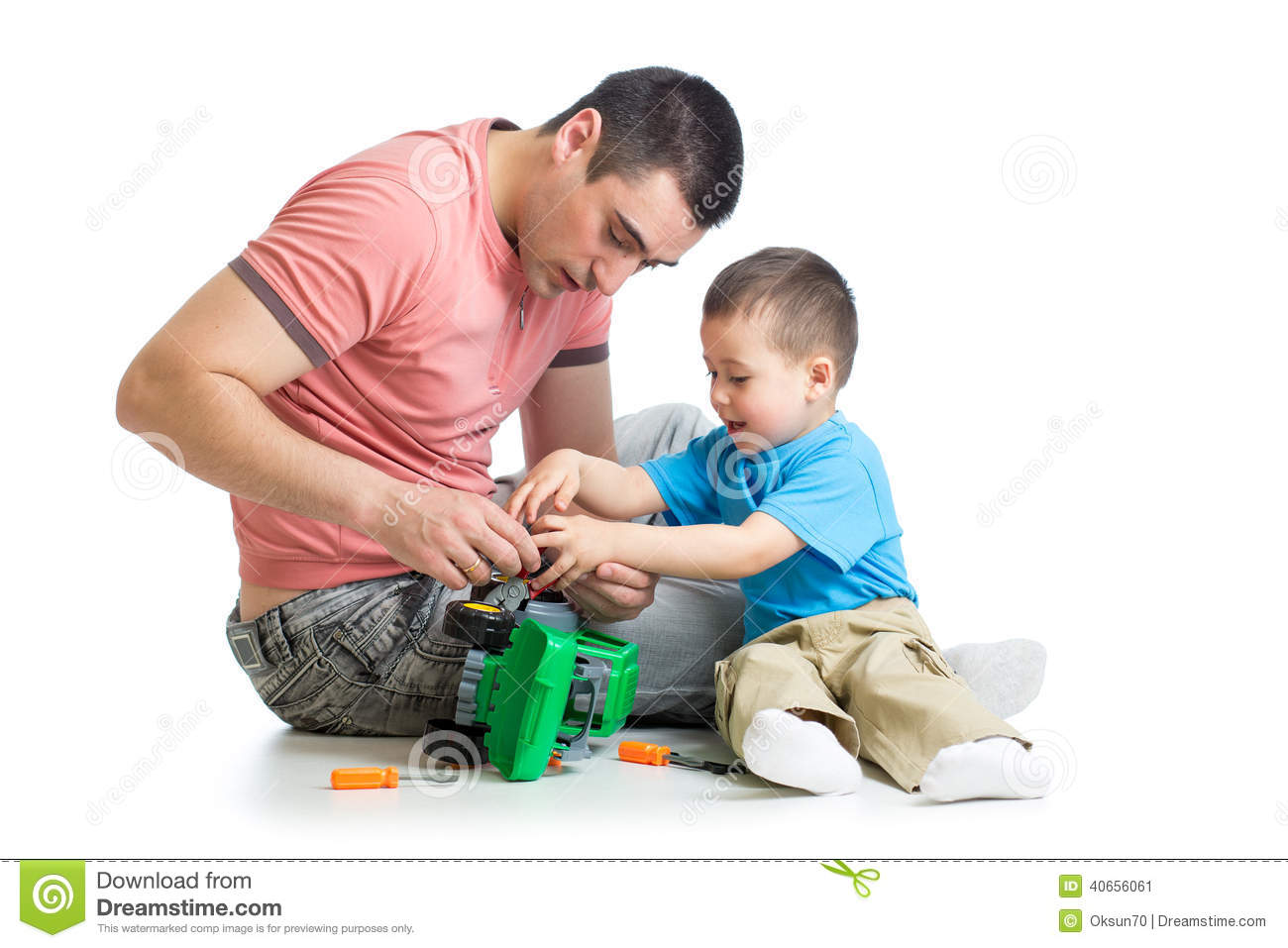 Toys For Dads : Kid boy and his father repair toy car stock image