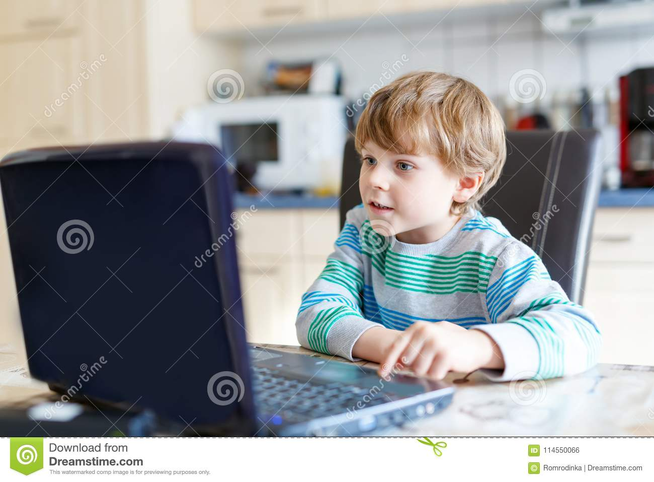 Kid Boy Surfing Internet And Playing On Computer Stock Photo