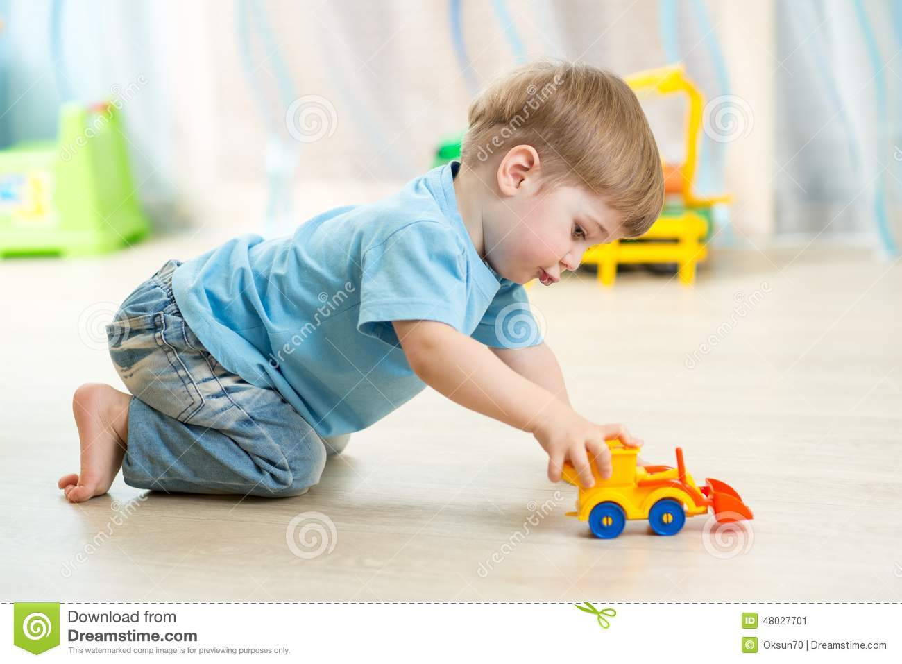Baby Boy Toy Cars : Blond boy playing with colorful car toy stock image