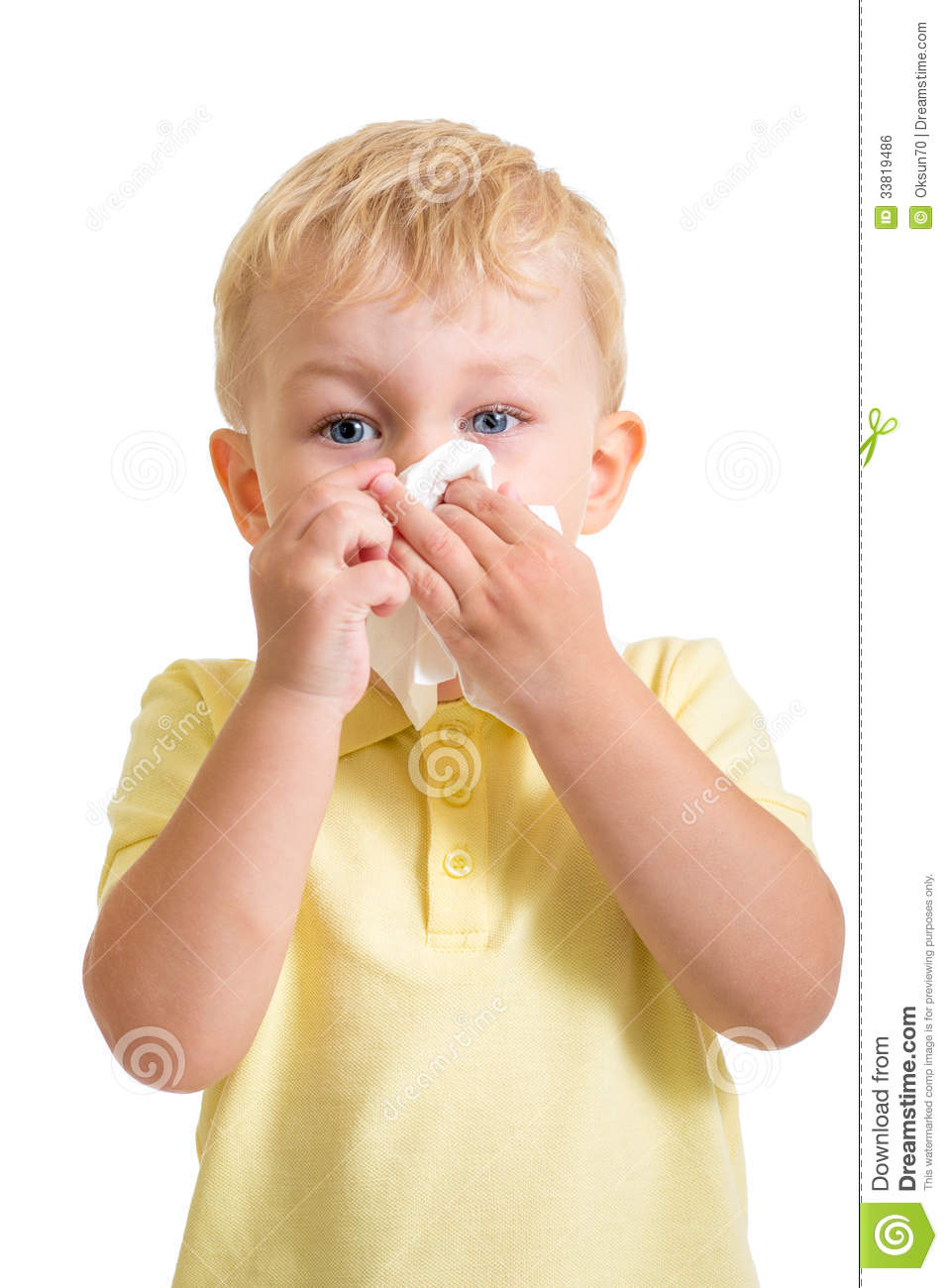 Kid cleaning nose with tissue isolated
