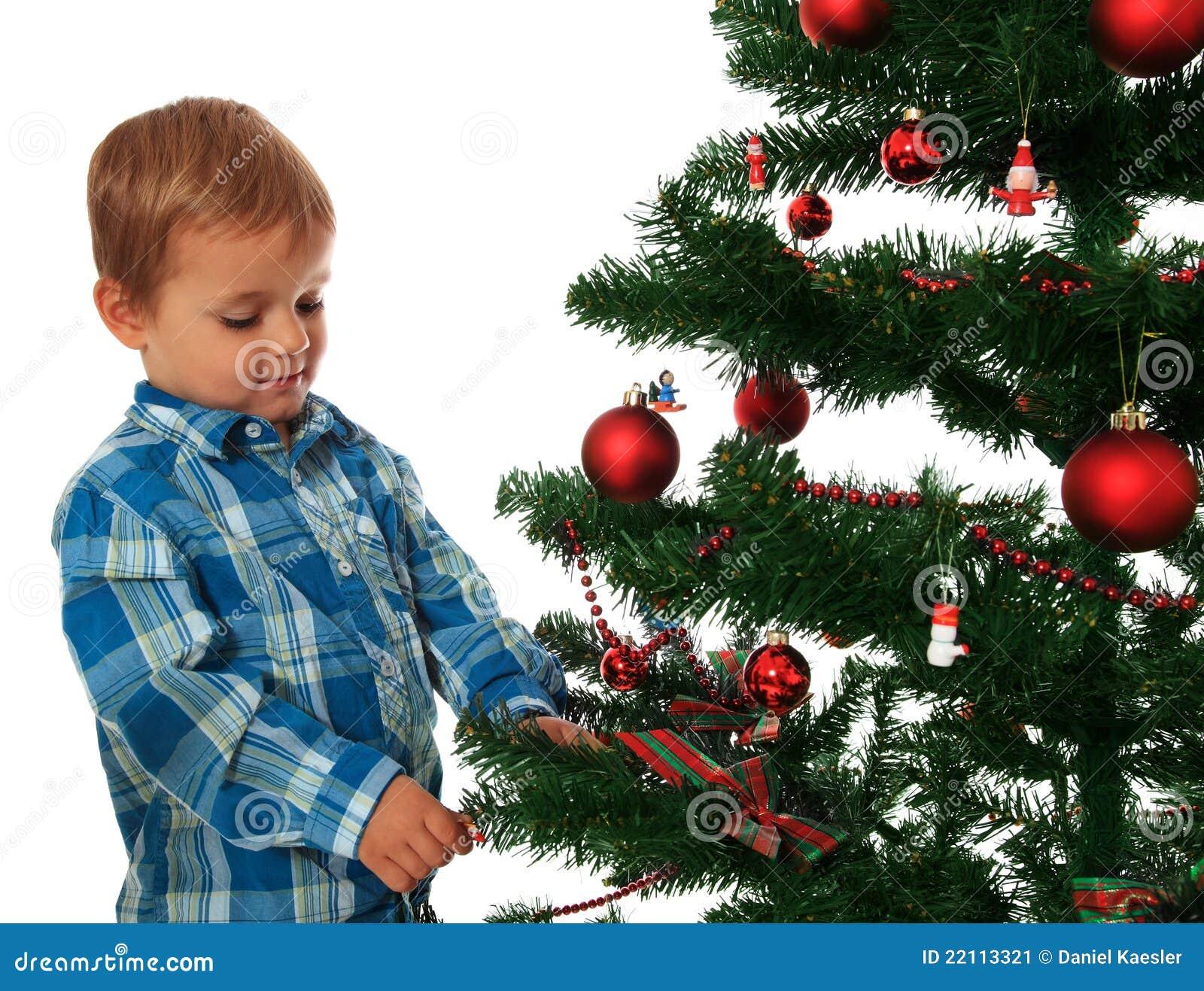 Kids Decorating Christmas Tree: Kid Decorating Christmas Tree Stock Image