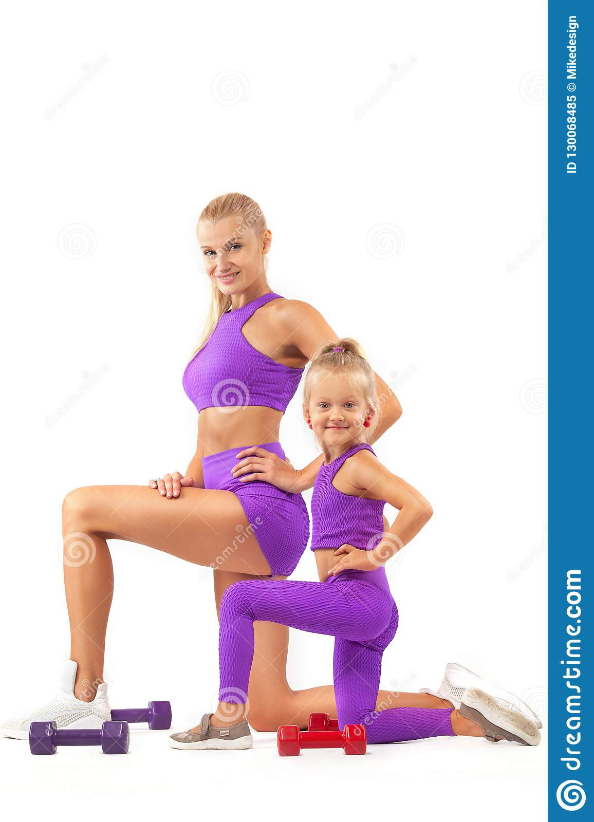 Mother Trainer And Kid Girl Doing Fitness Or Yoga Exercises