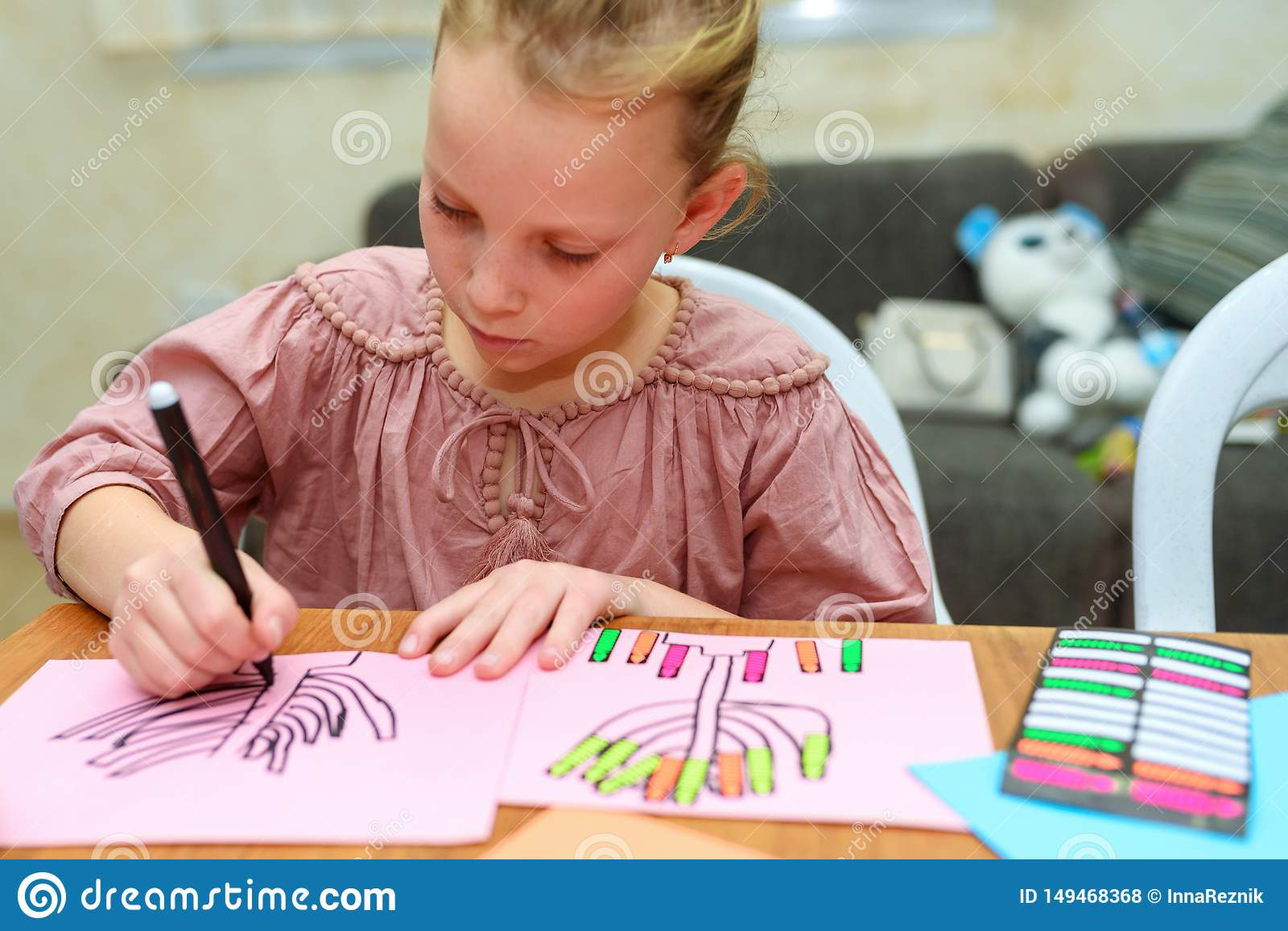 Kid Draw and Play With Stickers. Playing with stickers can help child on important developmental areas.