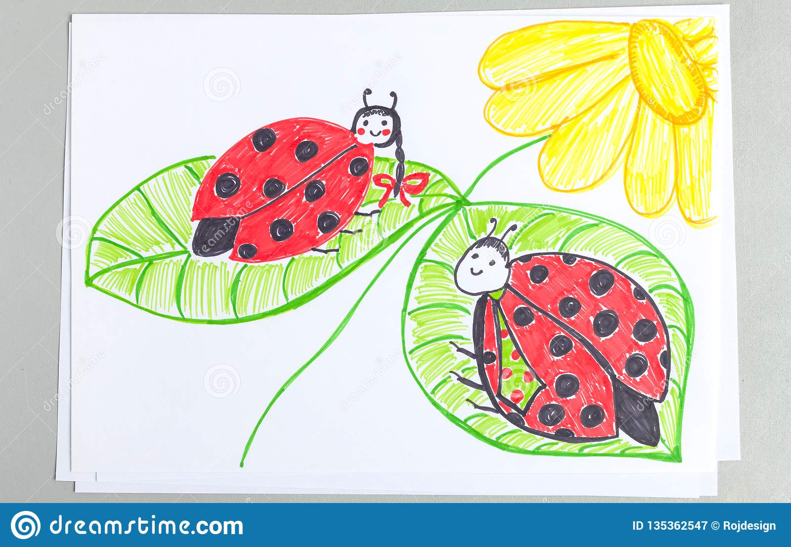 Kid drawing of two cute ladybugs sitting on green leaves of flower