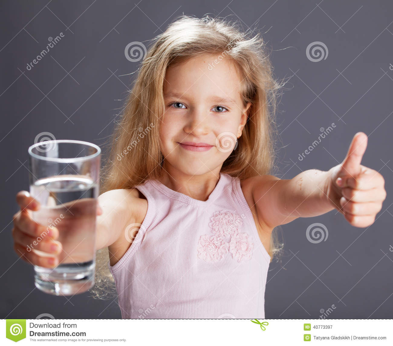 Kid drinking water from glass
