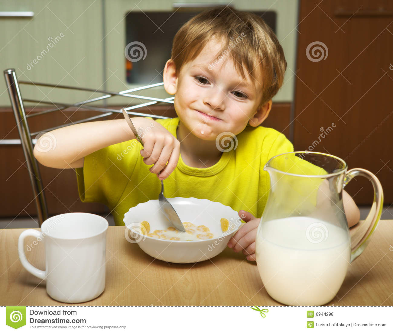 Kid eating breakfast stock photo. Image of nutrition ...