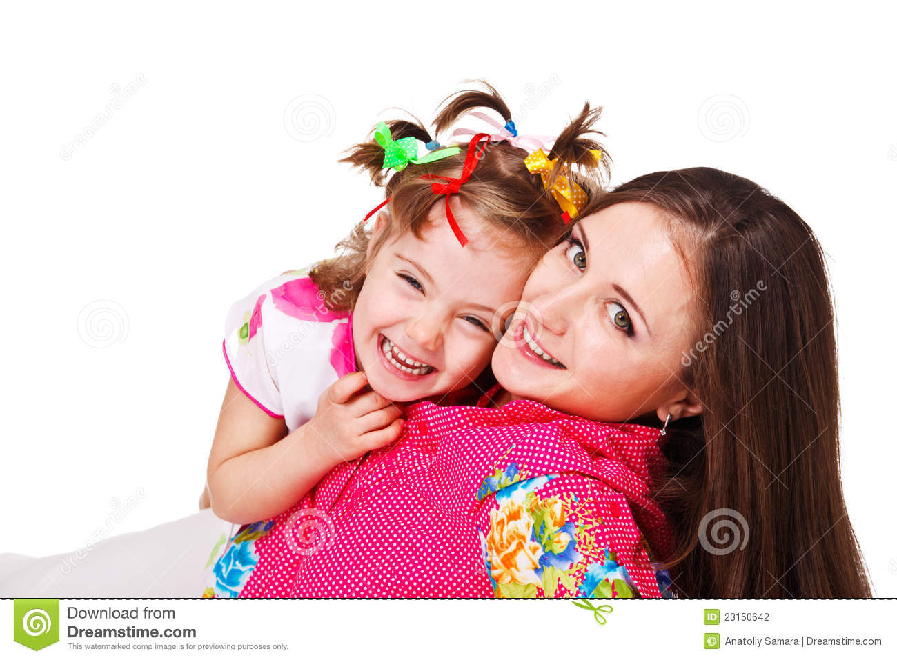 Kid embracing beautiful mother
