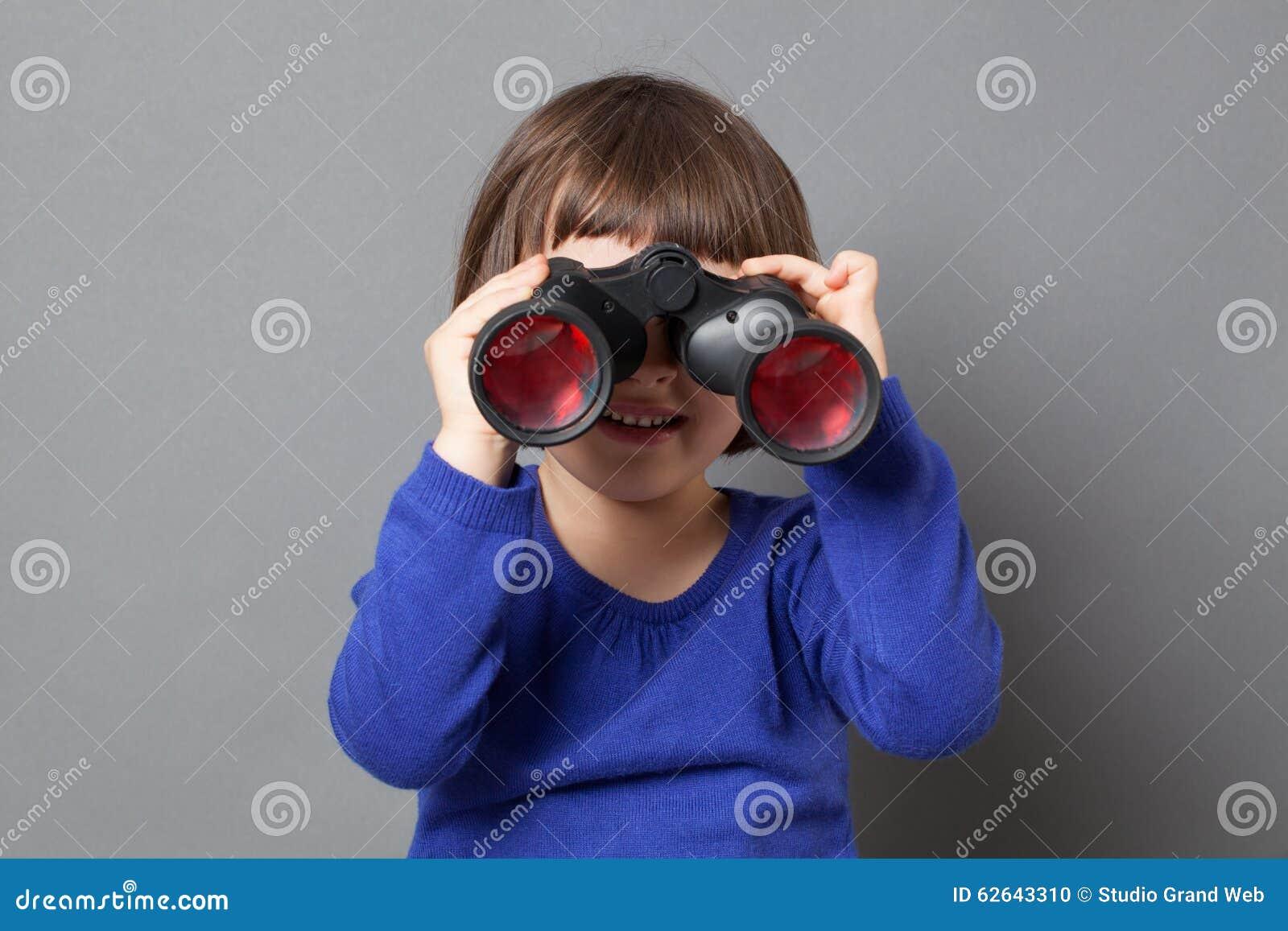 Kid exploration concept with binoculars