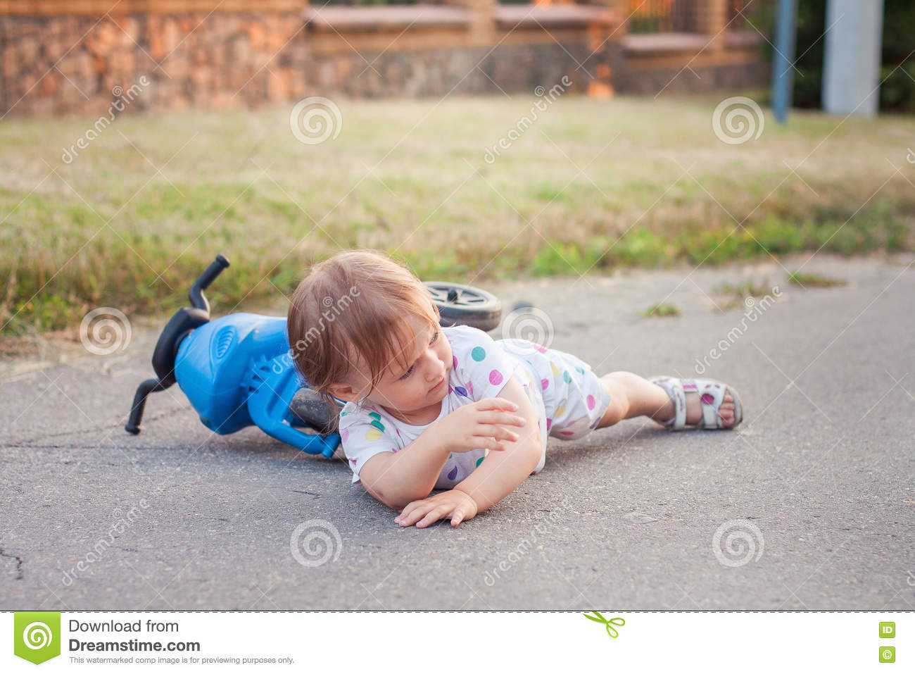 Kid Fell Down Of Her Bike Stock Photo - Image: 74856440