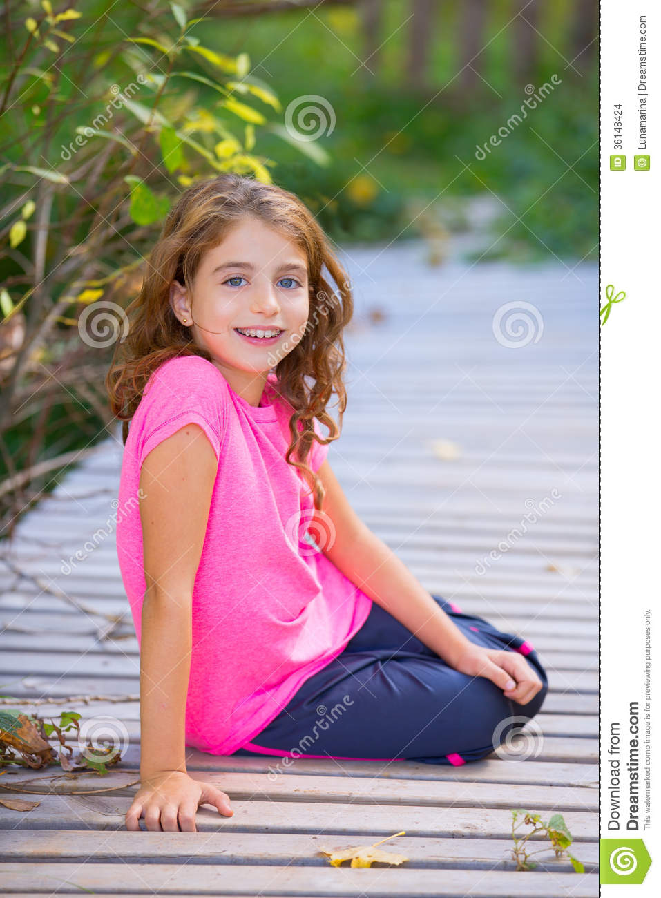 Kid Girl In Autumn Smiling With Braces Teeth Apparatus ...