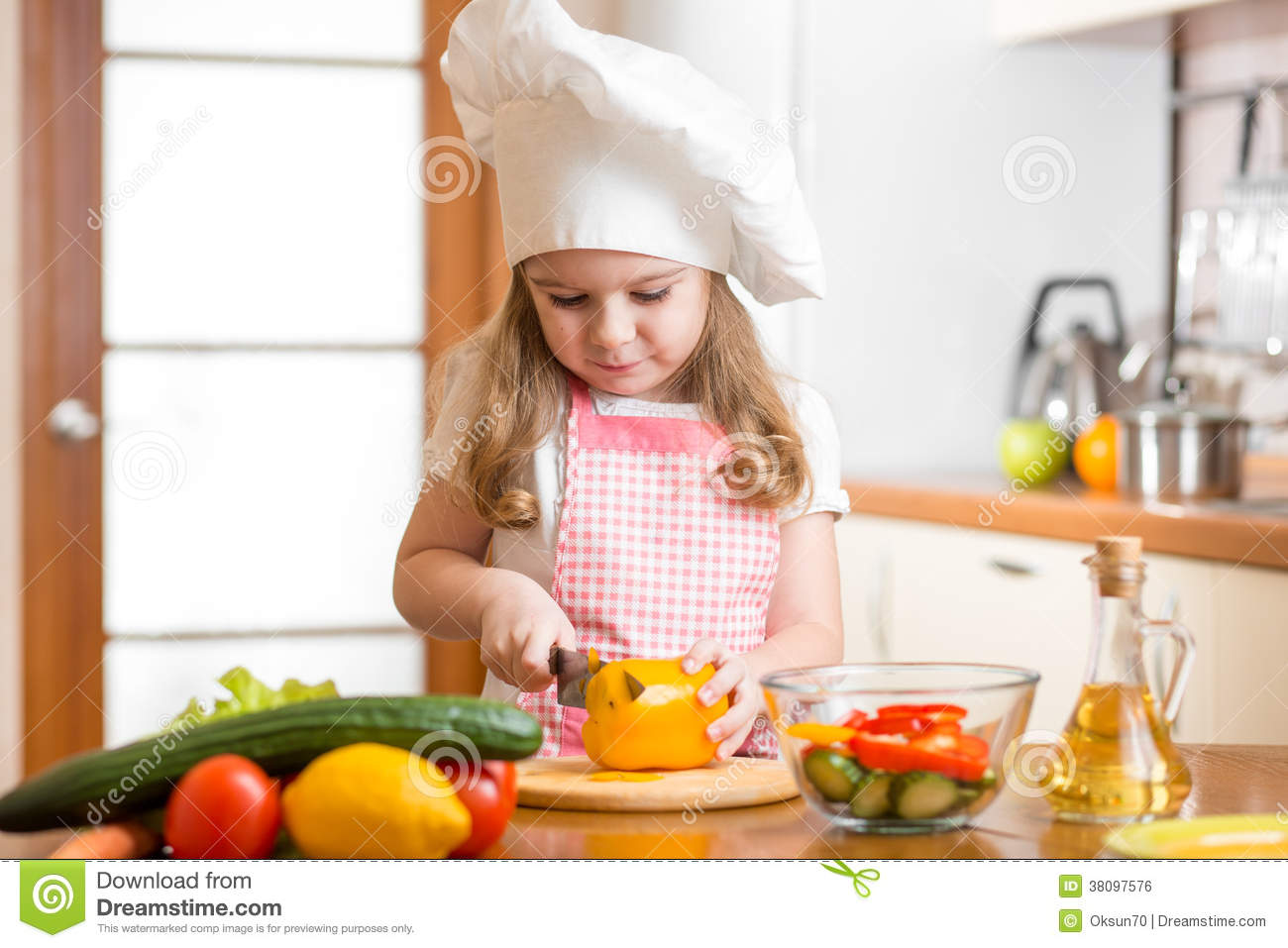 Vegetable chopping knife - Kid Girl Cook Cutting Vegetables Royalty Free Stock Image Image