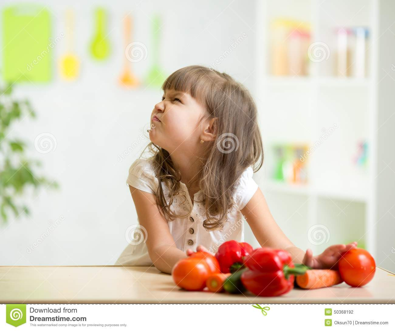 kid girl with expression of disgust against stock photo