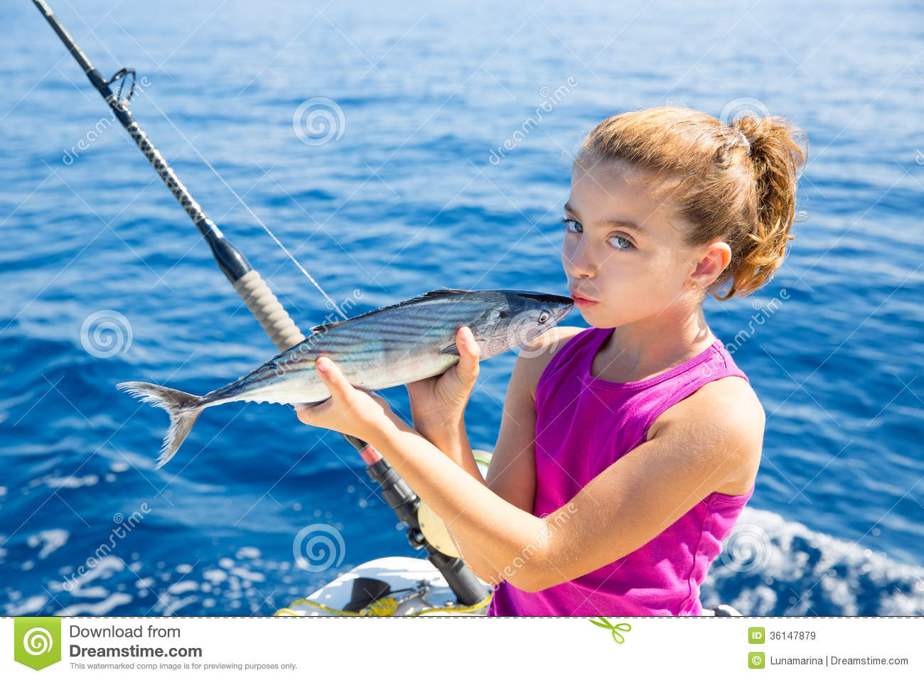 kid girl fishing tuna bonito sarda kissing fish for
