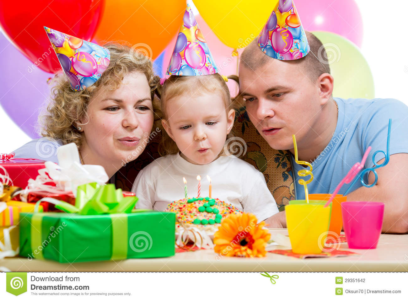 Kid Girl With Parents Blow Birthday Candles