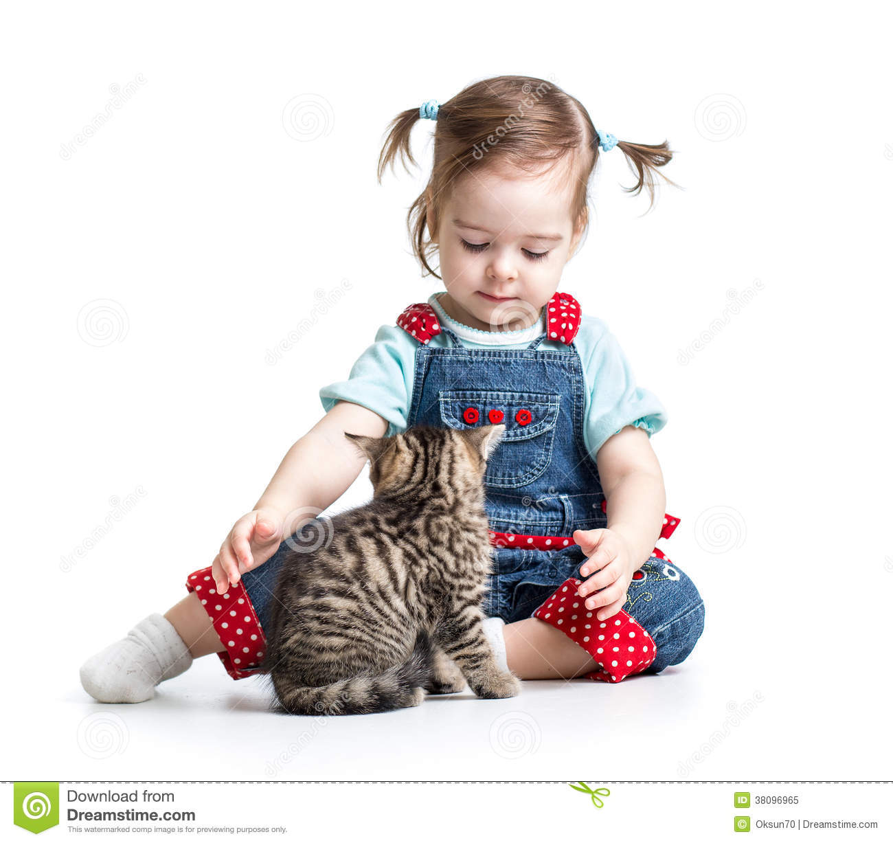 Kid girl playing with cat