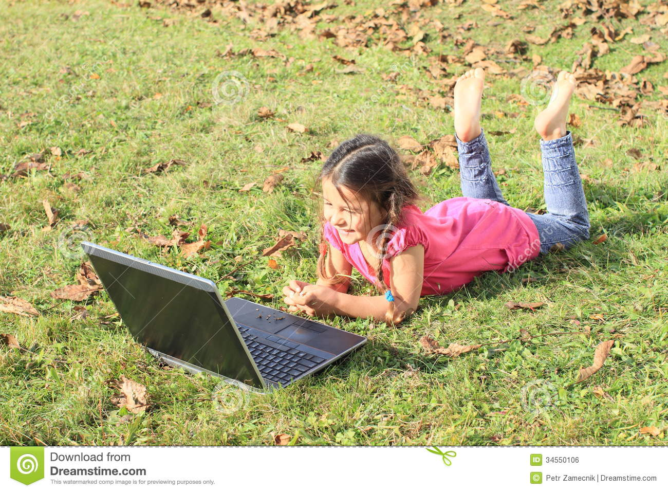 Kid - girl playing with notebook