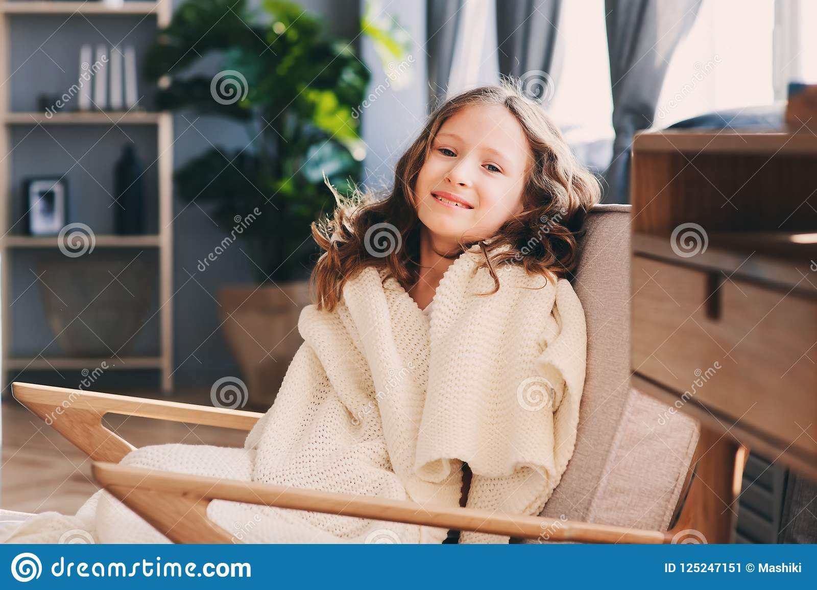 Miraculous Kid Girl Relaxing In Cozy Chair At Home Stock Image Image Pabps2019 Chair Design Images Pabps2019Com