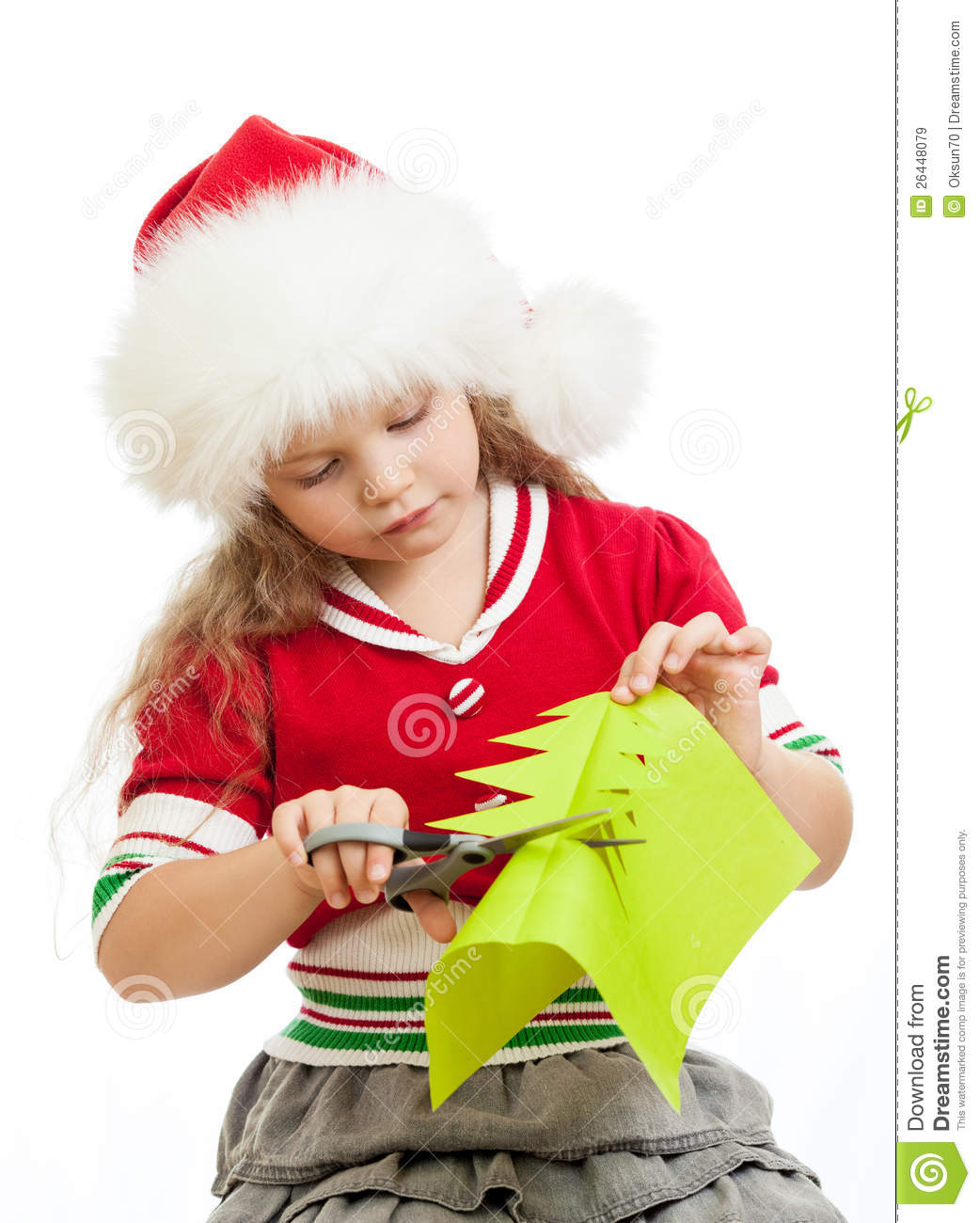 Kid Girl In Santa Claus Hat Cutting Paper Tree Royalty
