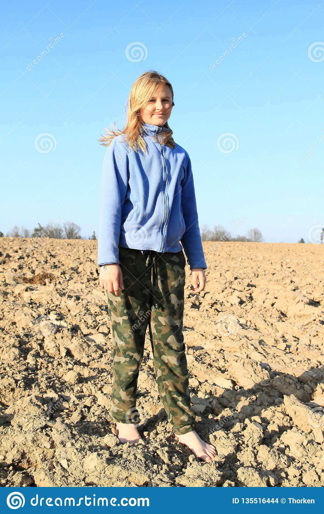 Kid - girl standing on field