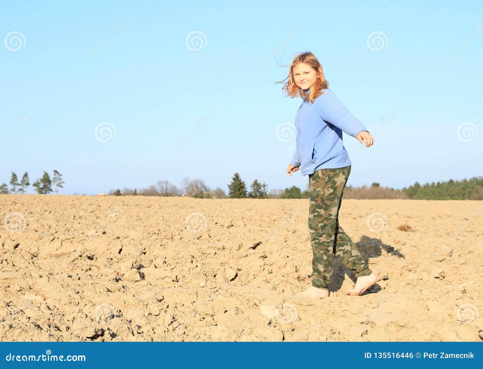 Kid - girl walking on field