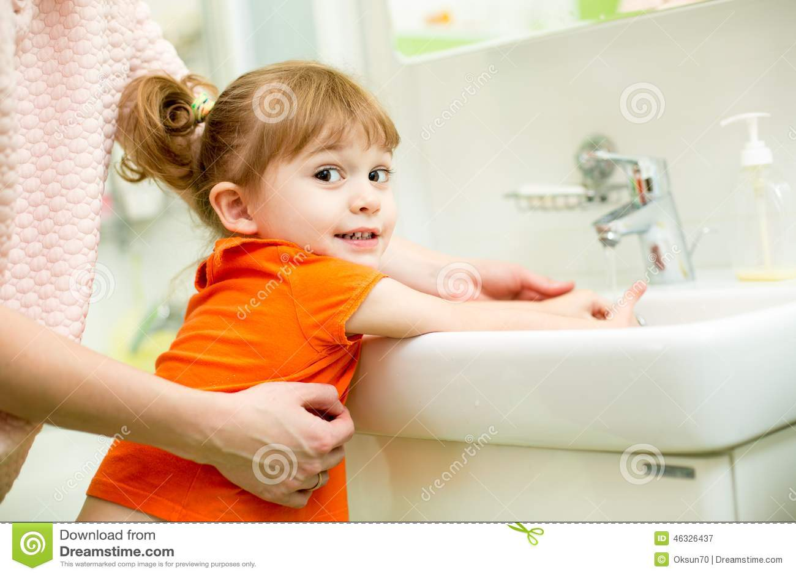 Kid Girl Washing Hands With Mom Help Stock Photo Image